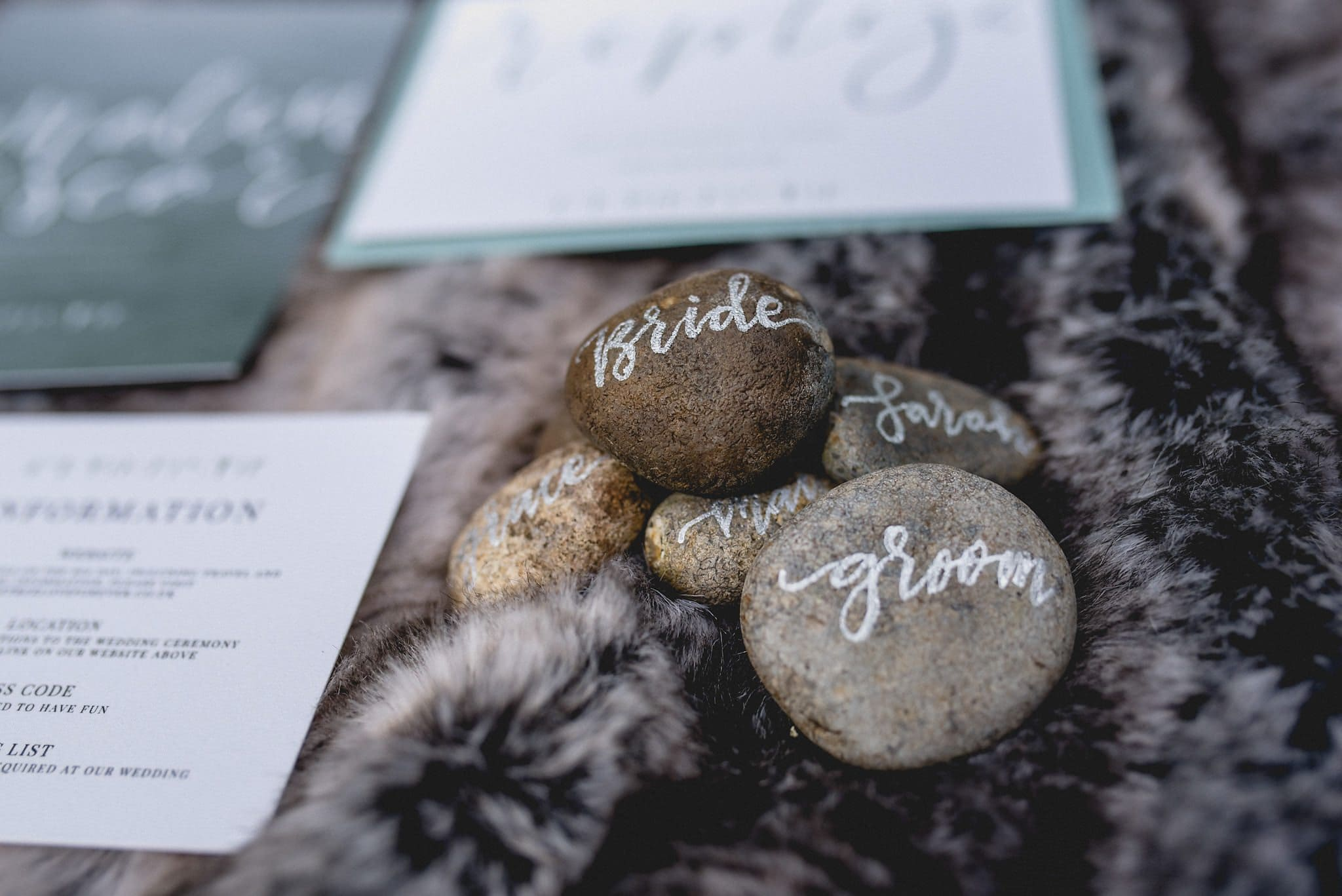 Close up of calligraphied pebbles on grey fur throw