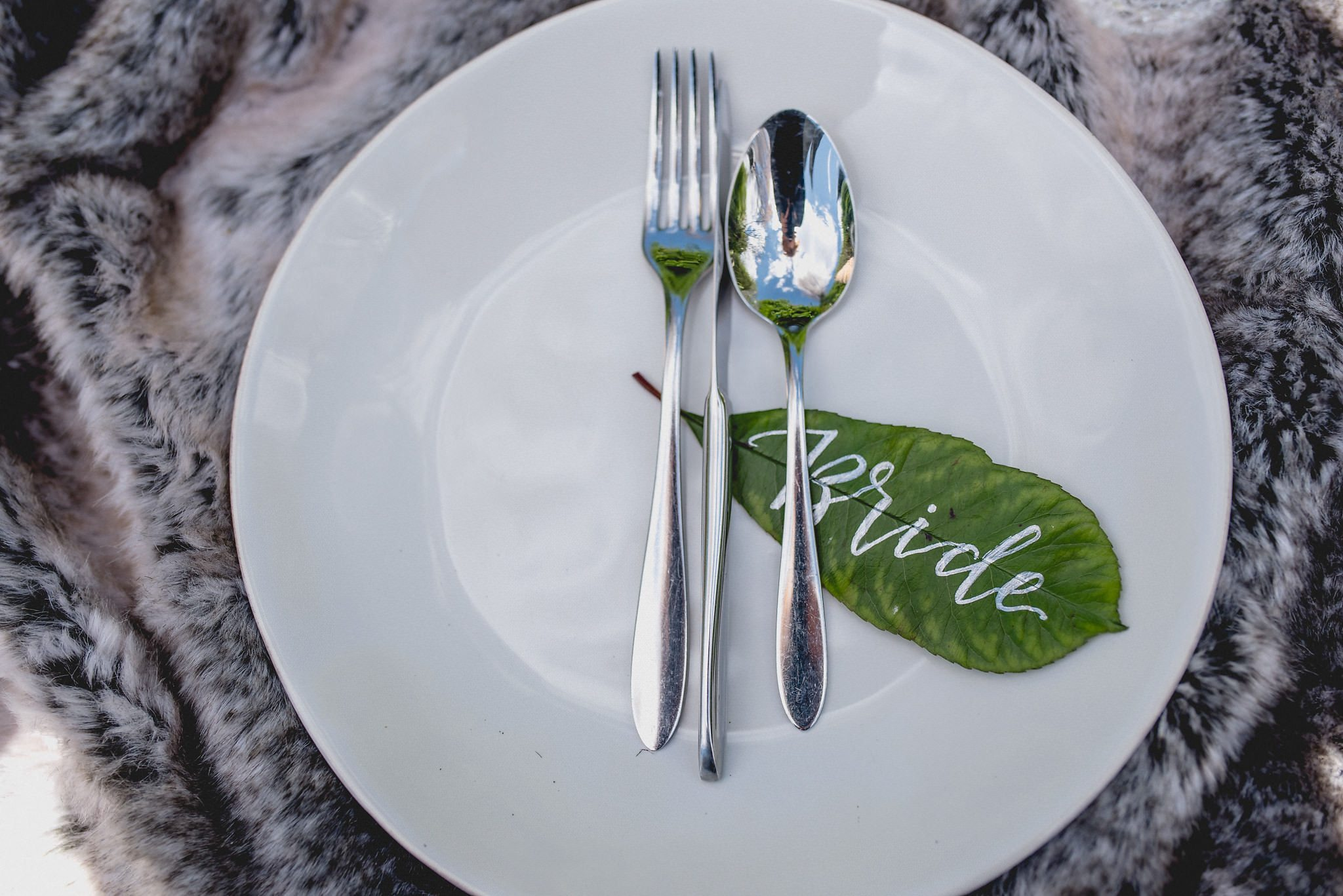 Close up of bride place setting with calligraphy on leaf