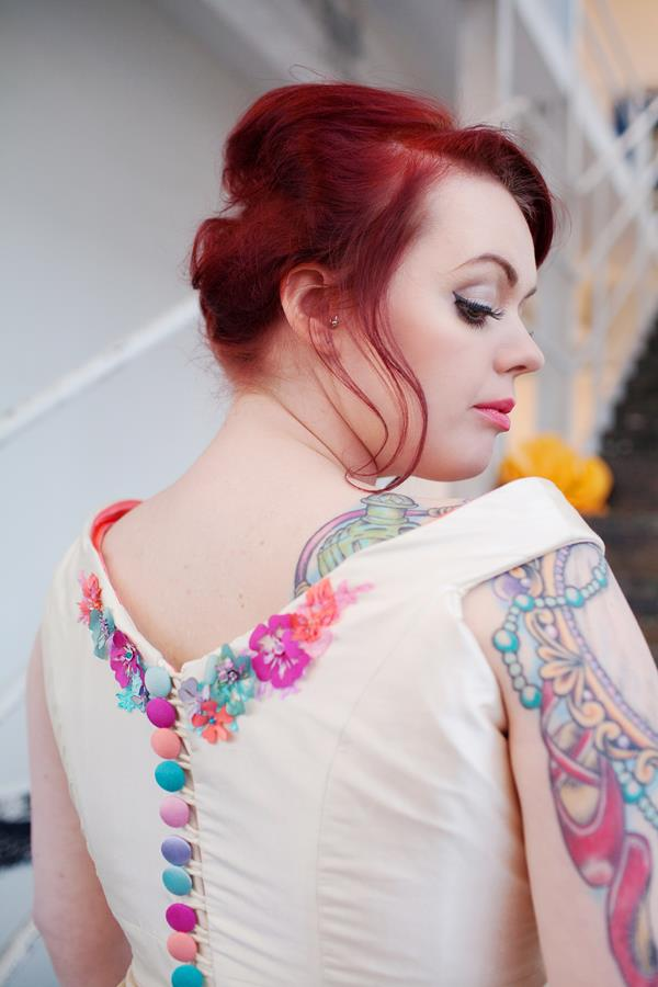 Bride wearing bespoke appliqued dress by the Couture Company