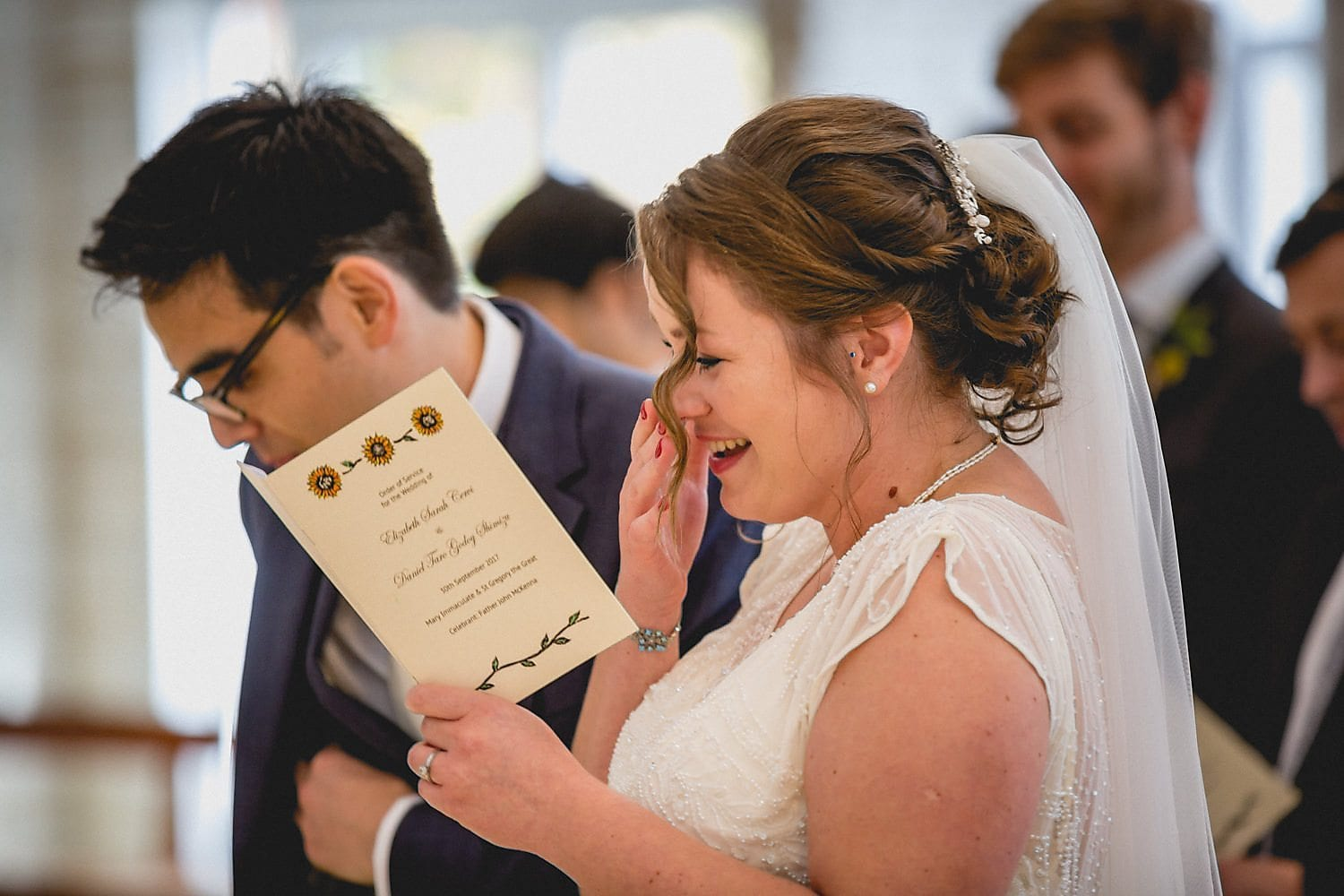 Bride Elizabeth gets emotional while reading the order of service