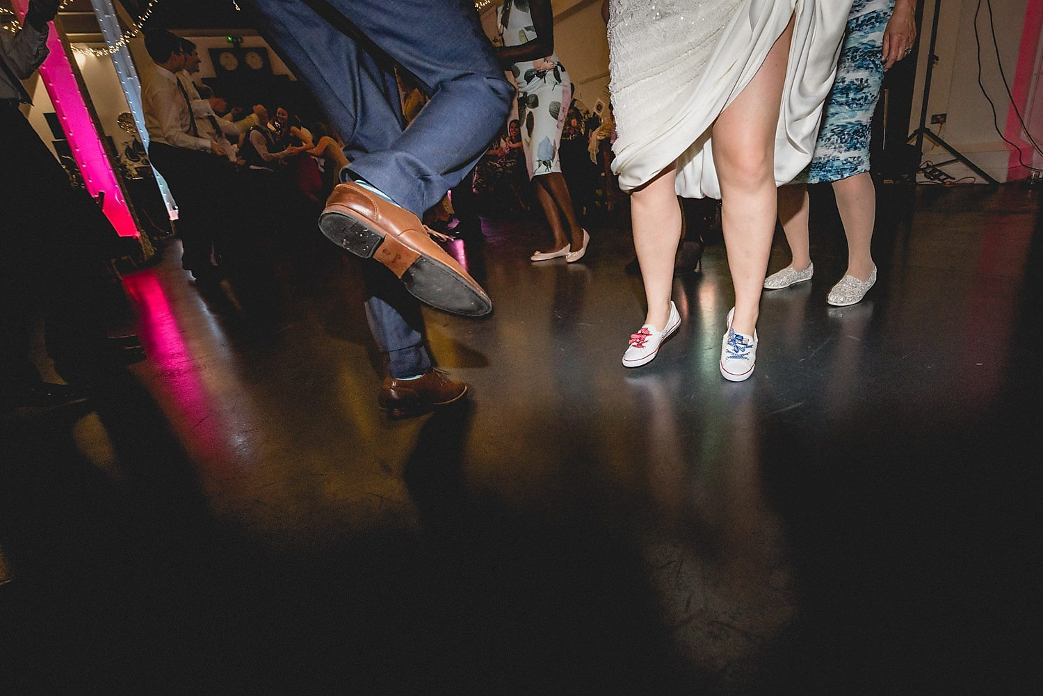 The bride and groom's feet, mid jumping and leaping during the Ceilidh