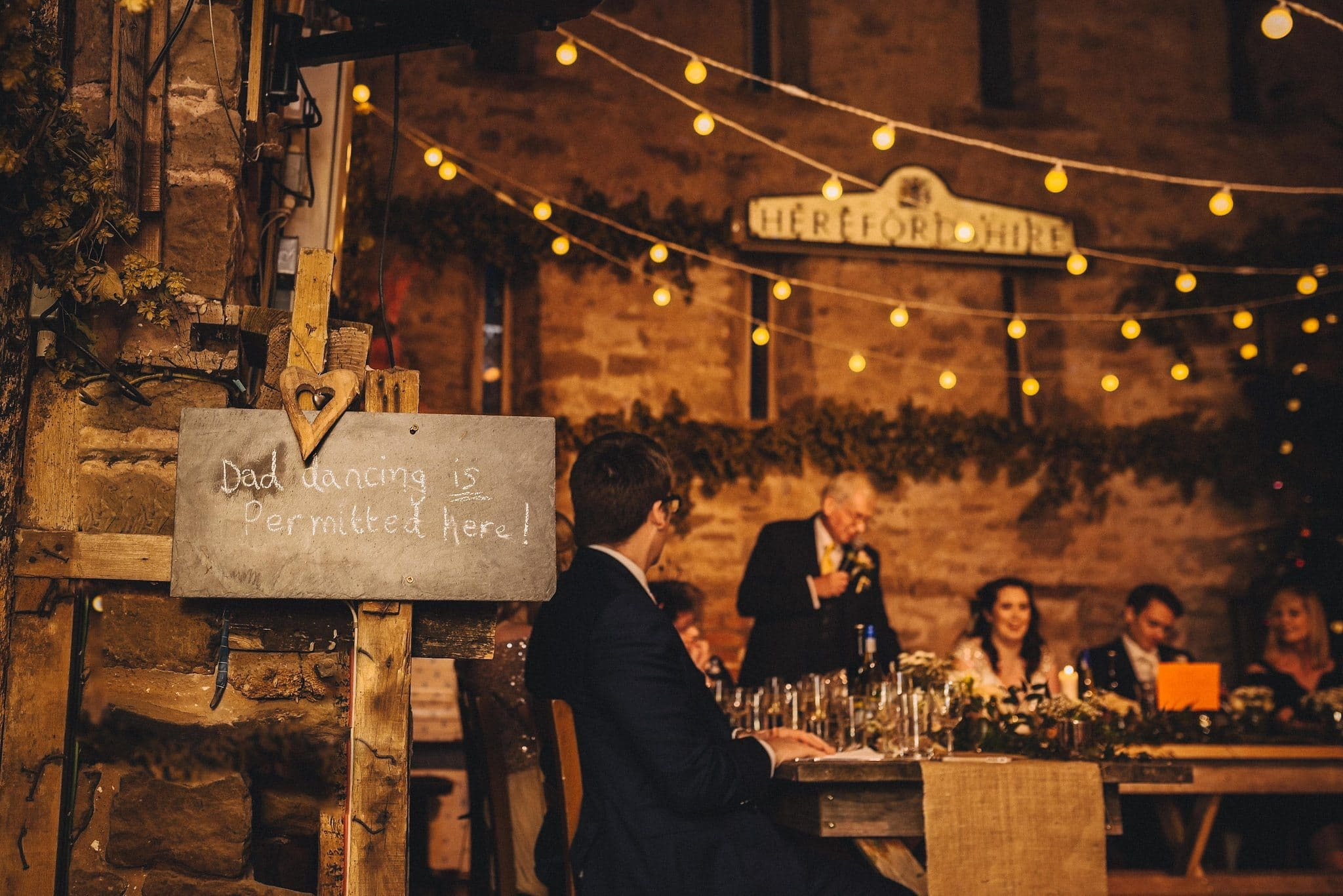 Chalkboard sign 'Dad dancing is permitted here' is displayed next to the top table at Lyde Court