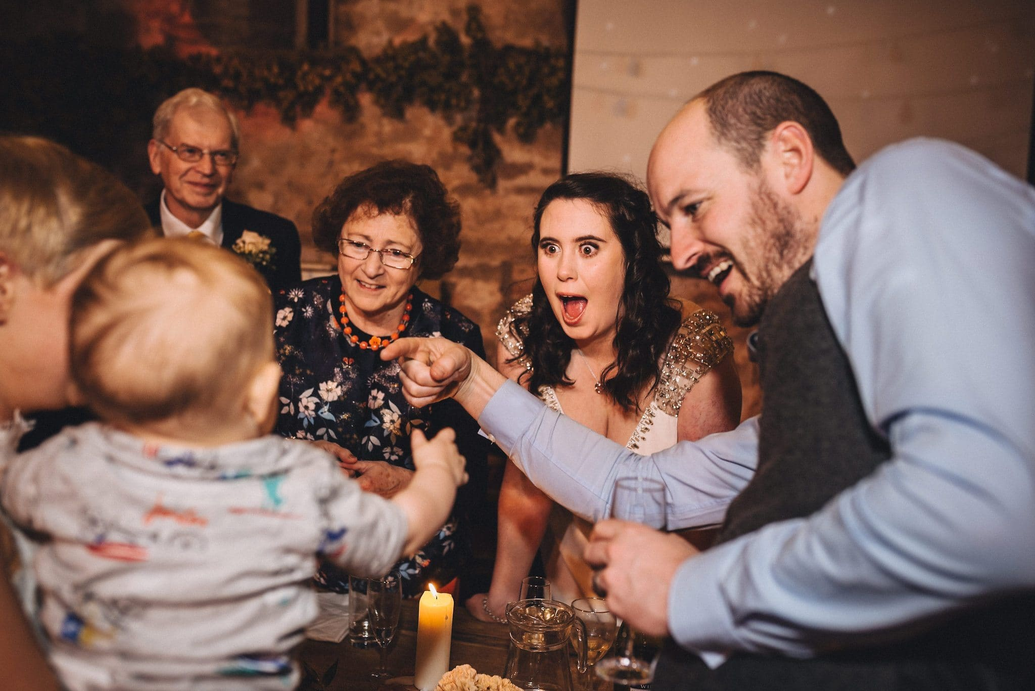 Bride and other guests coo over a baby