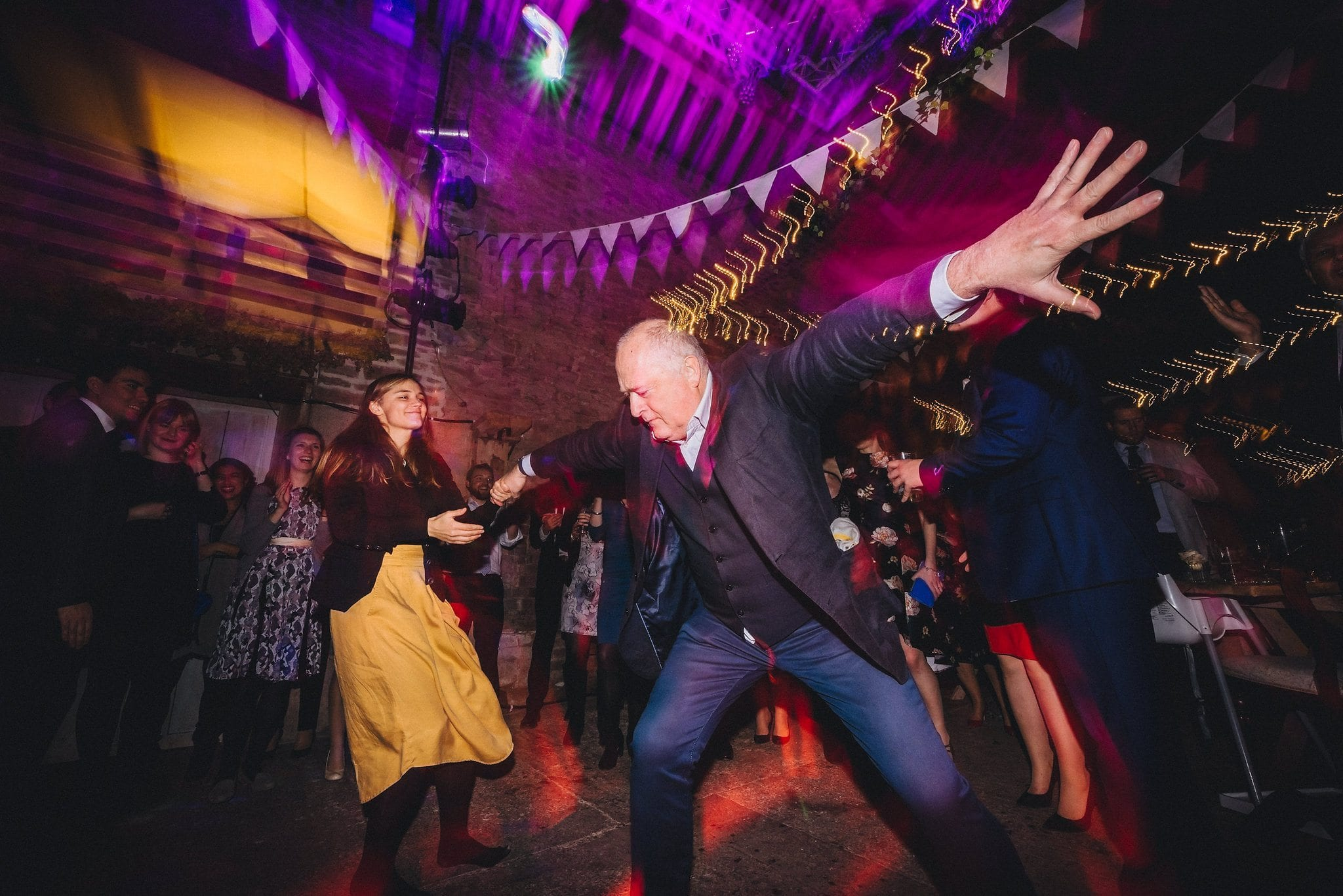 Male guest shows off his moves on the dancefloor at a Lyde Court Winter Wedding
