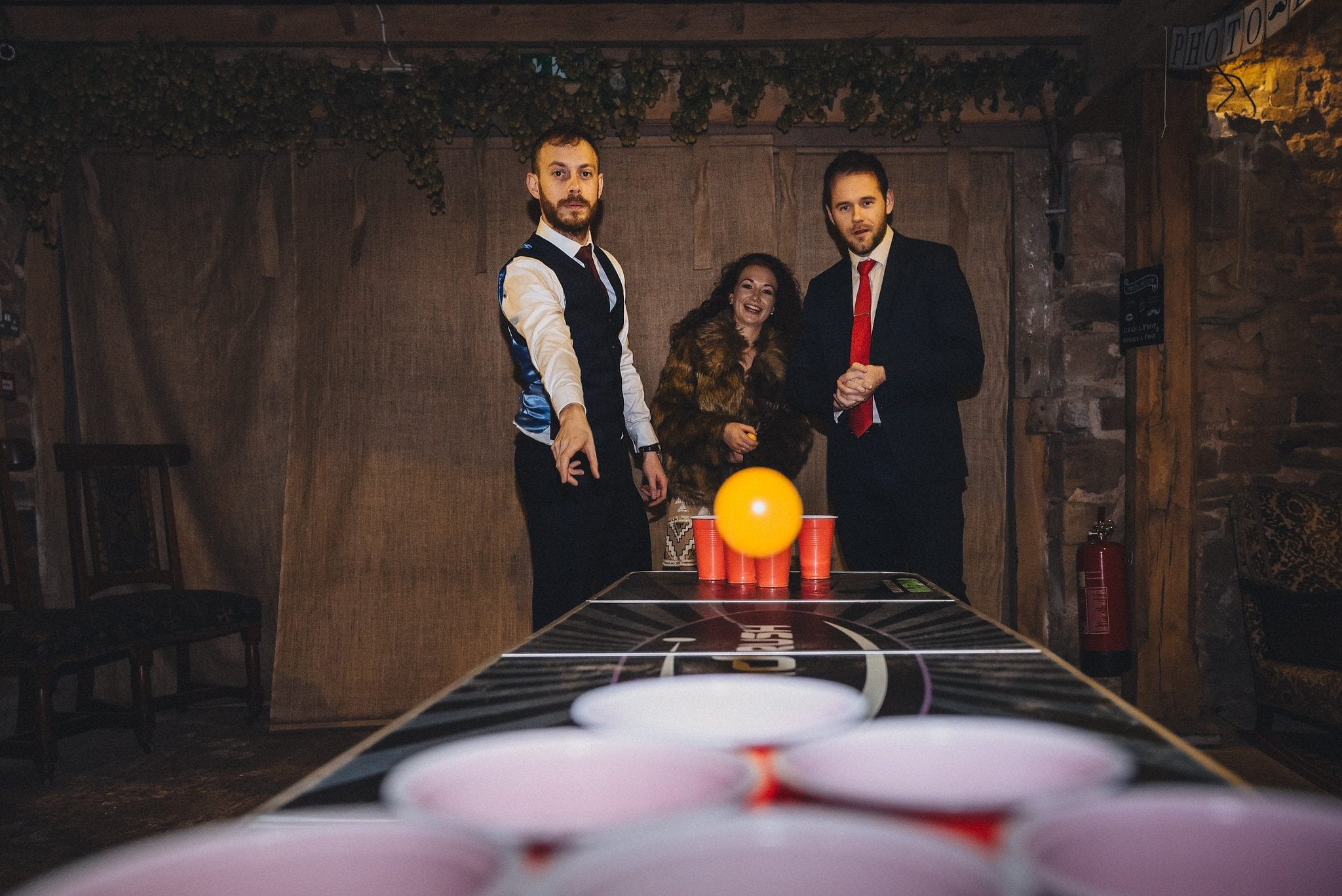 Beer pong action at Lyde Court winter wedding