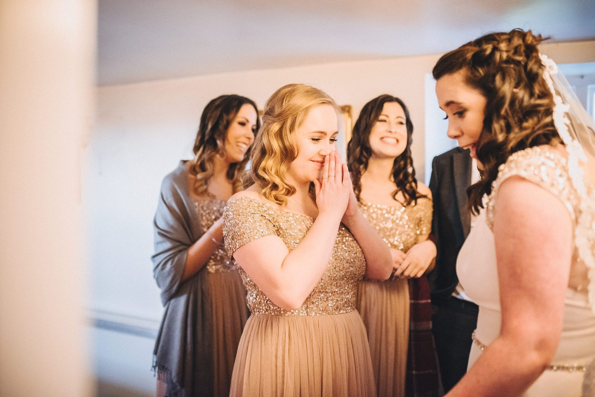 Bridesmaid gets emotional seeing bride in her dress for the first time