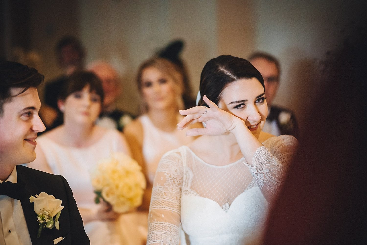 Bride wipes happy tears away