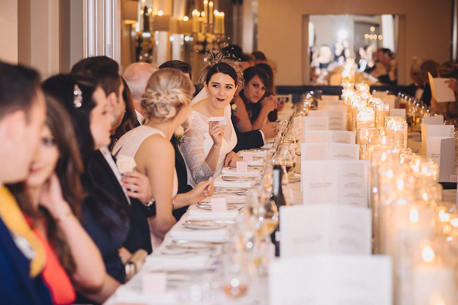 Guests sit for wedding breakfast at chic Bingham Hotel wedding