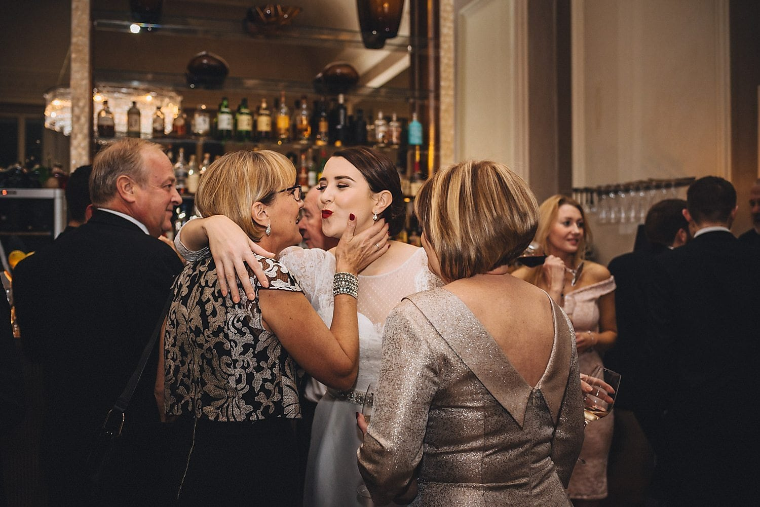 Bride greets guests with a kiss