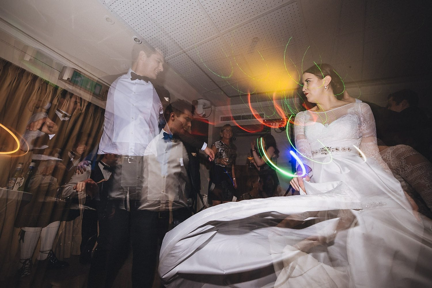 Bride twirls her dress on the dancefloor