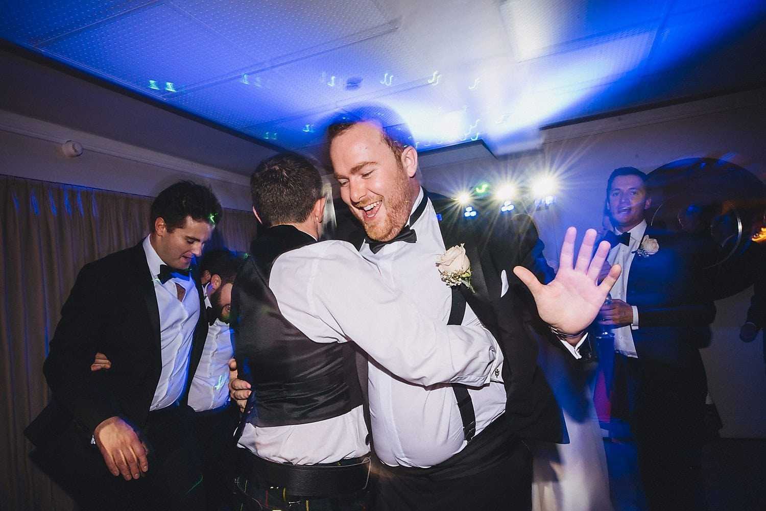 Male guests show off their moves on the dancefloor