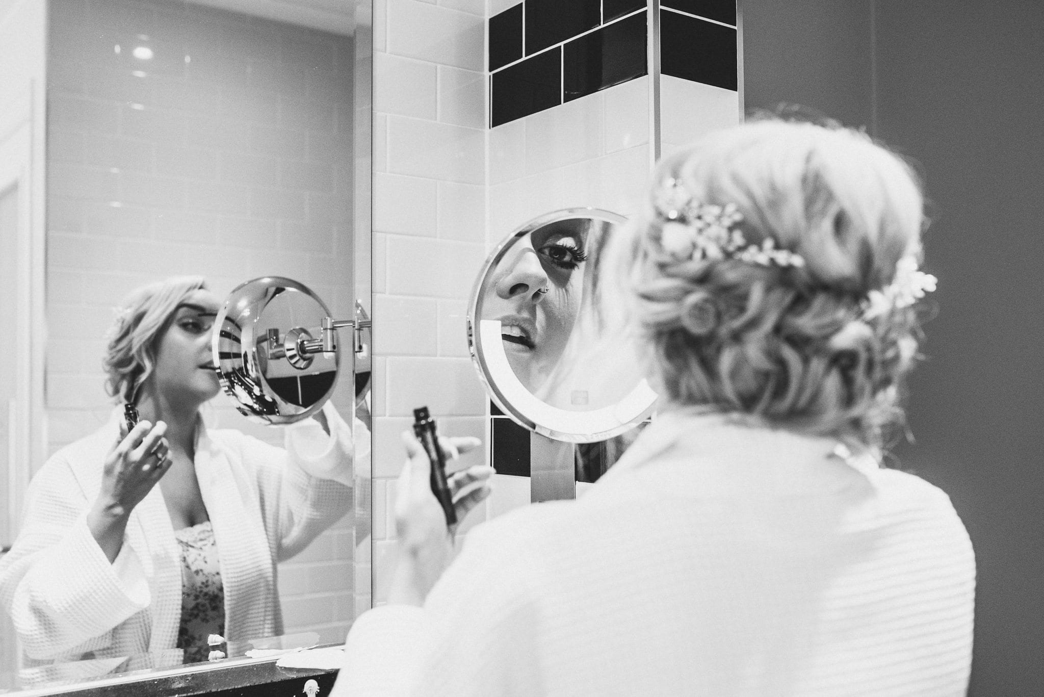 Black and white shot of bride getting ready for her Tower of London wedding