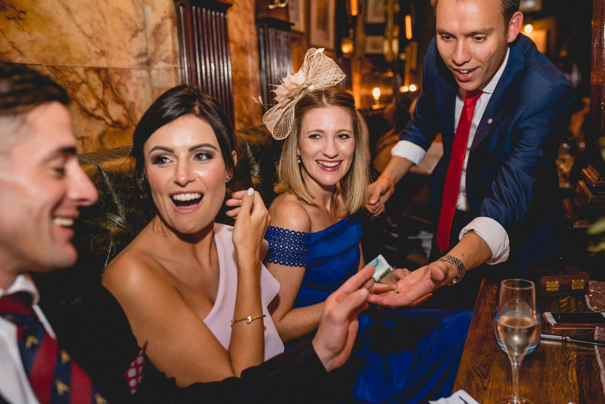Magician Neil Granger wows guests at the reception of this Tower of London wedding