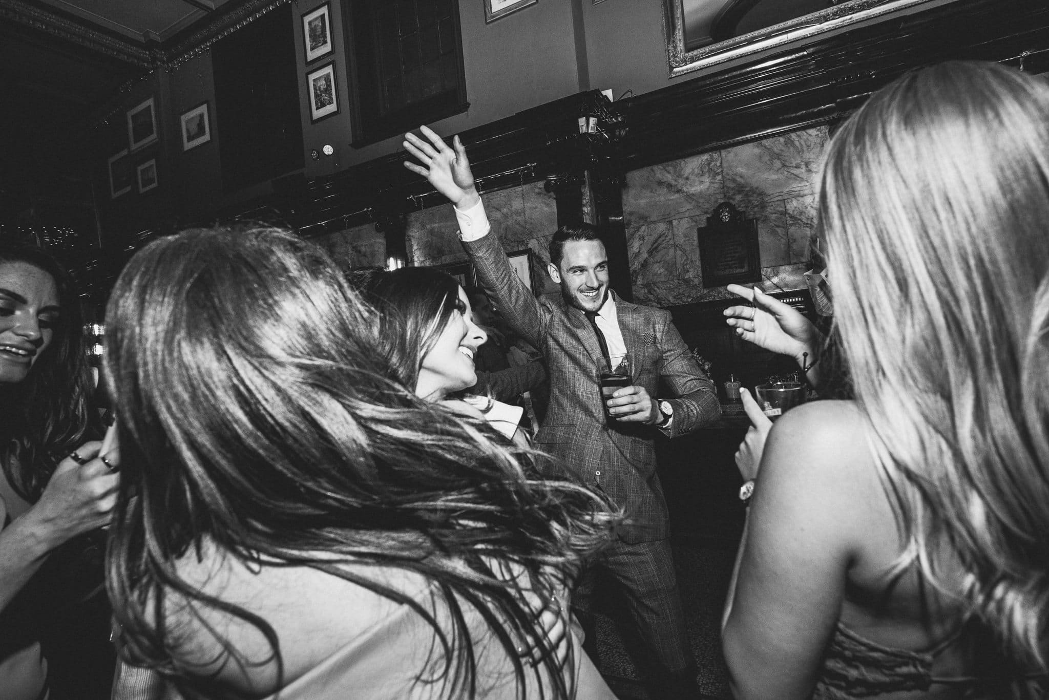 Black and white shot of packed dancefloor at the Counting House pub