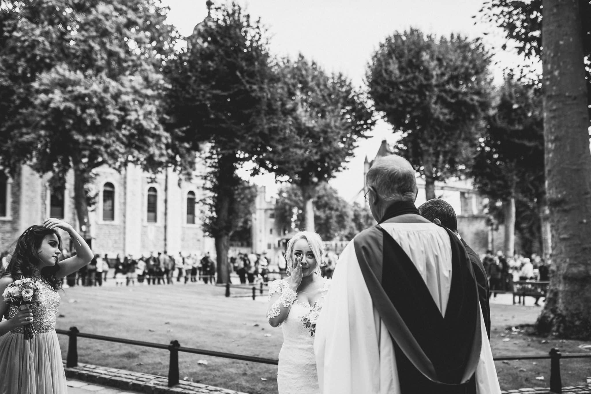 Bride gets emotional as priest greets her at the Tower of London