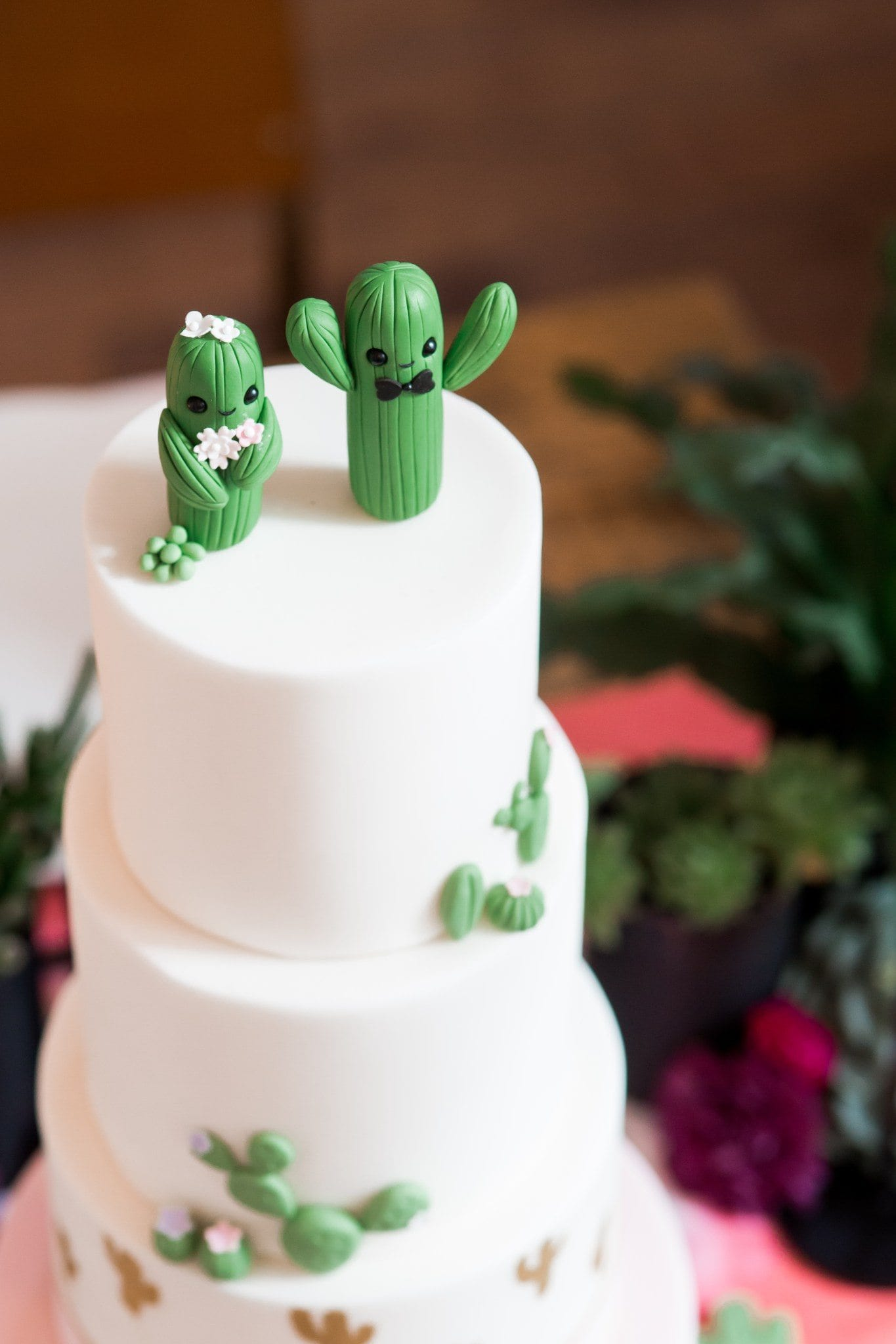 Tiered cake with bride and groom cactus fondant cake topper