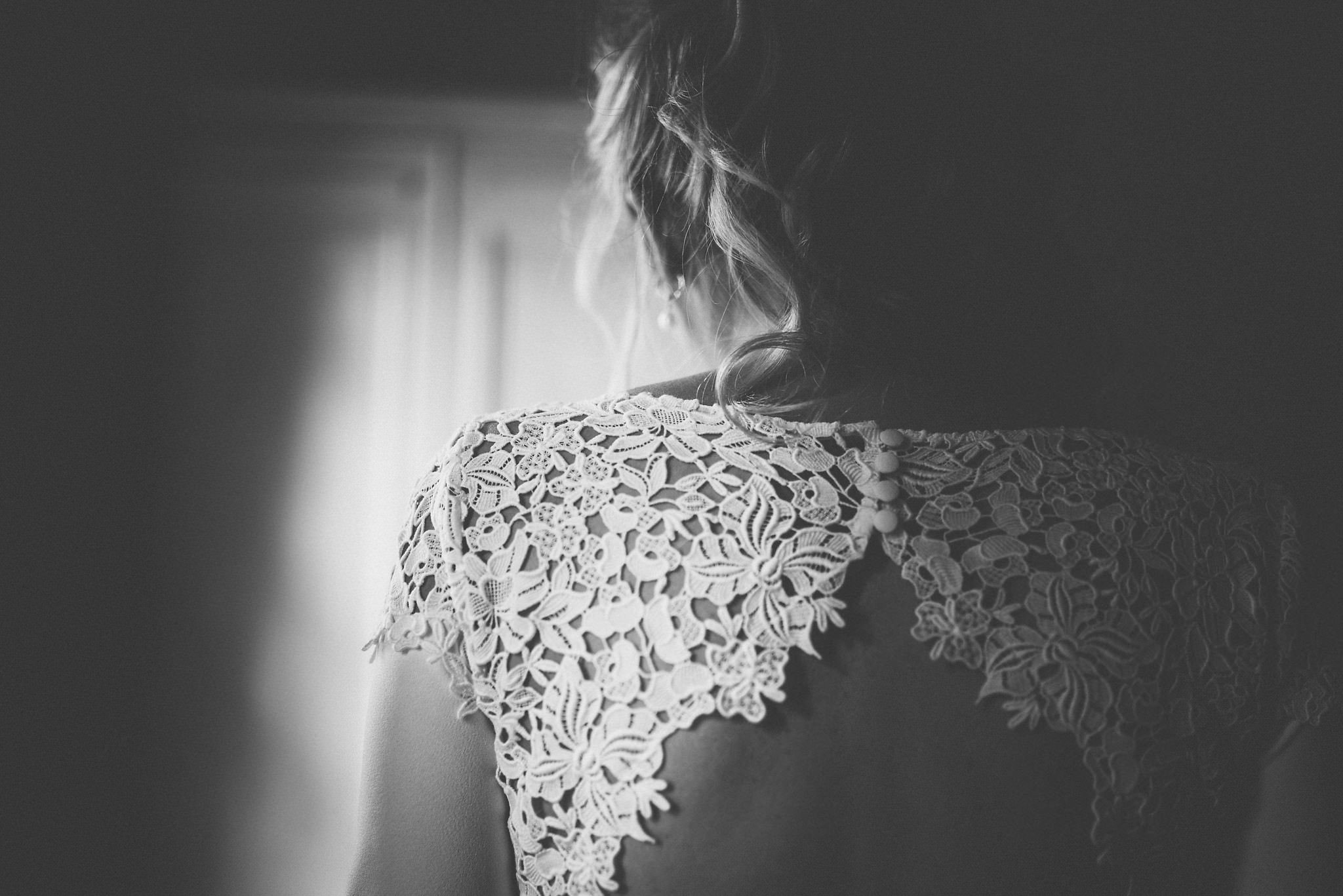 Black and white image of back detailing on bride's dress