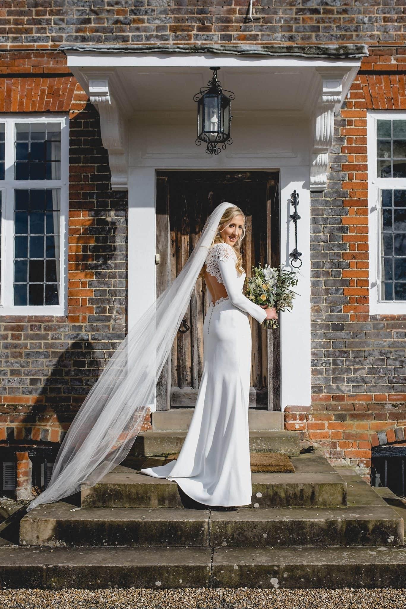 Bride looking over her shoulder in the door at Littlefield Manor