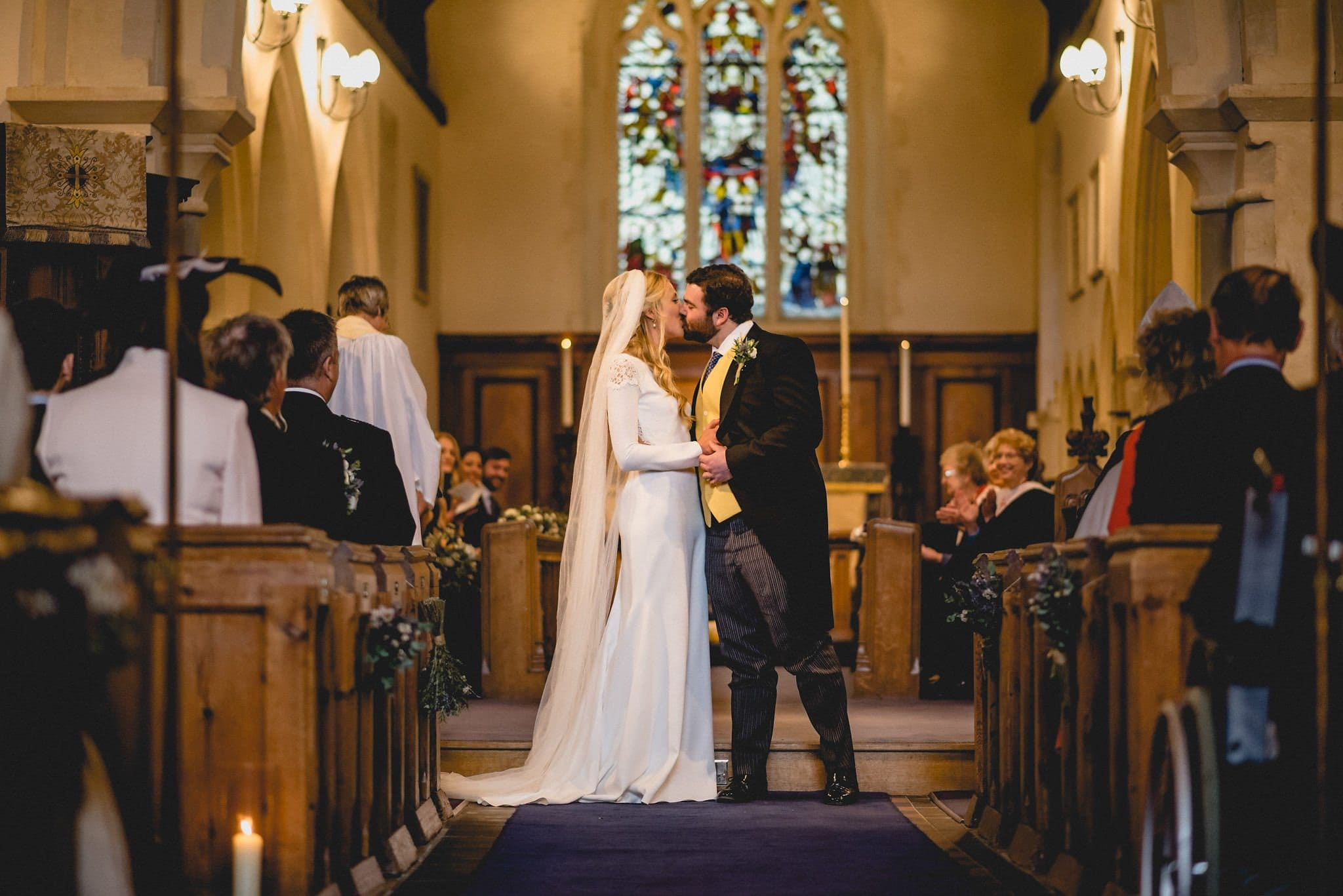 Bride and groom kiss in church