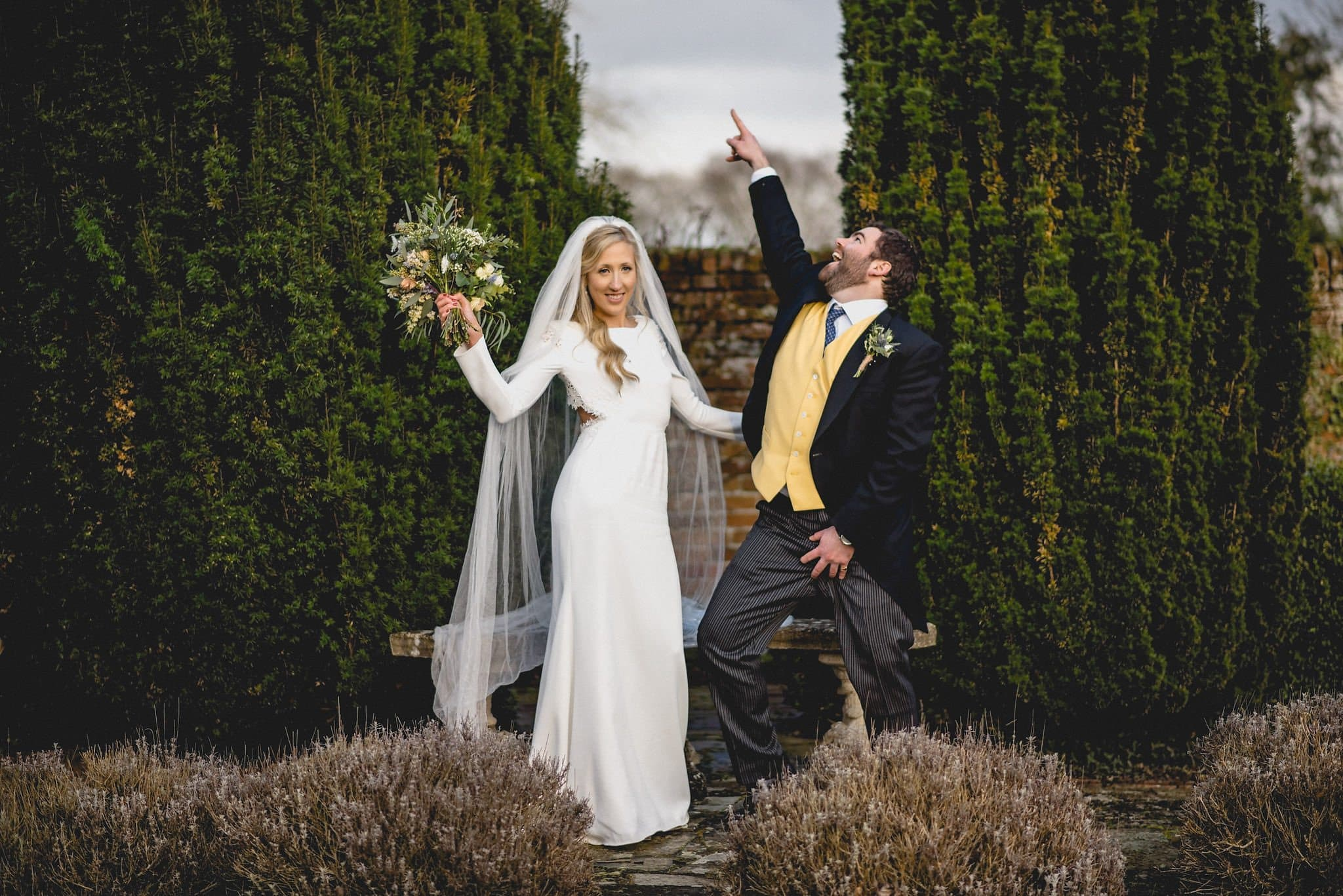 Bride and groom strike silly poses during couple's shoot