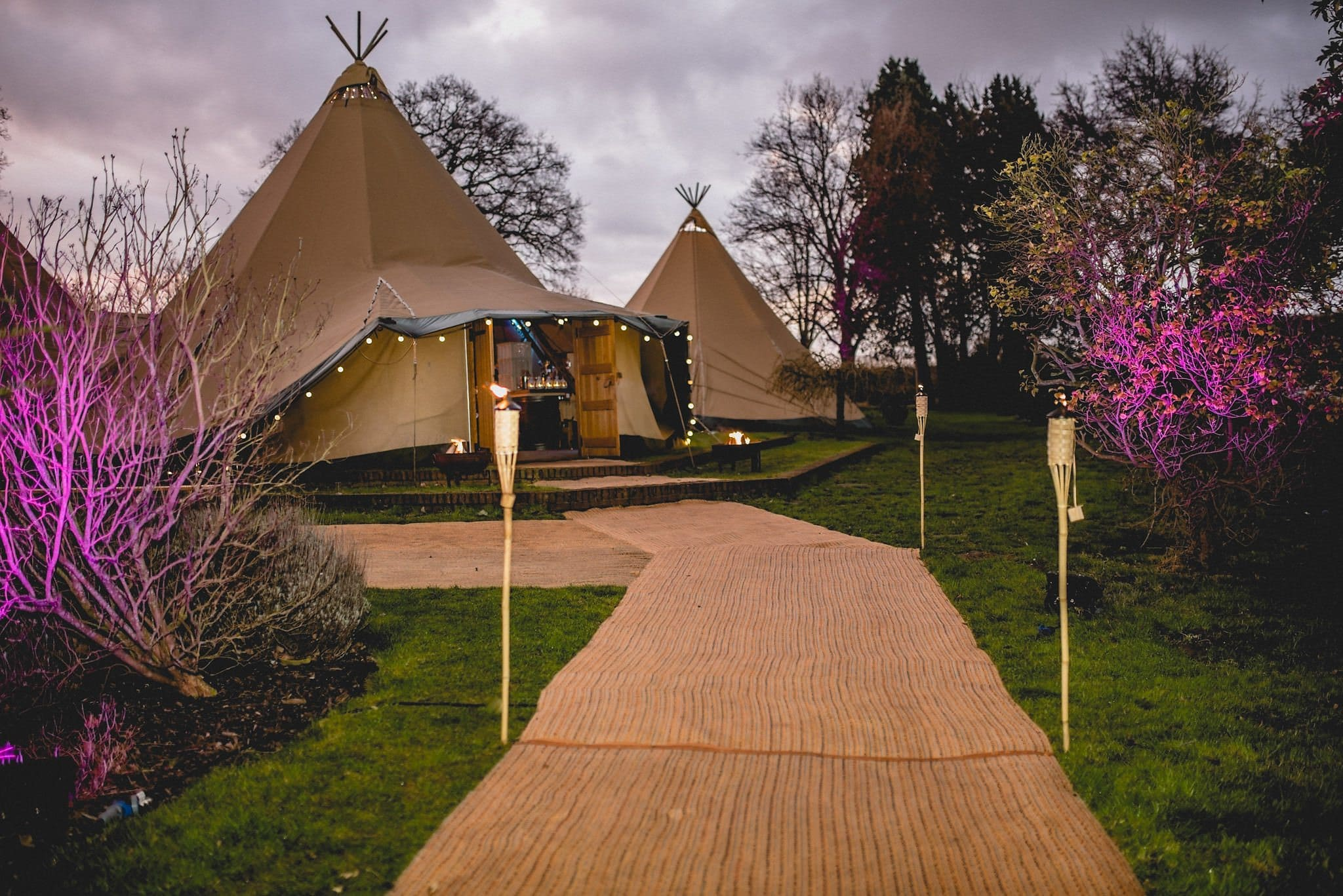 The walkway up to the tipi, complete with flaming torches
