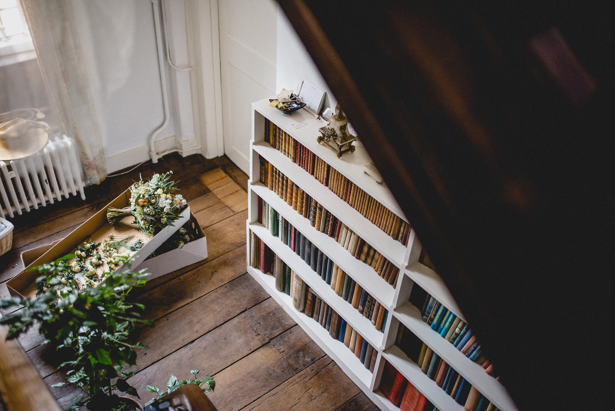 Shot from above of bookshelves and bouquets at Littlefield Manor