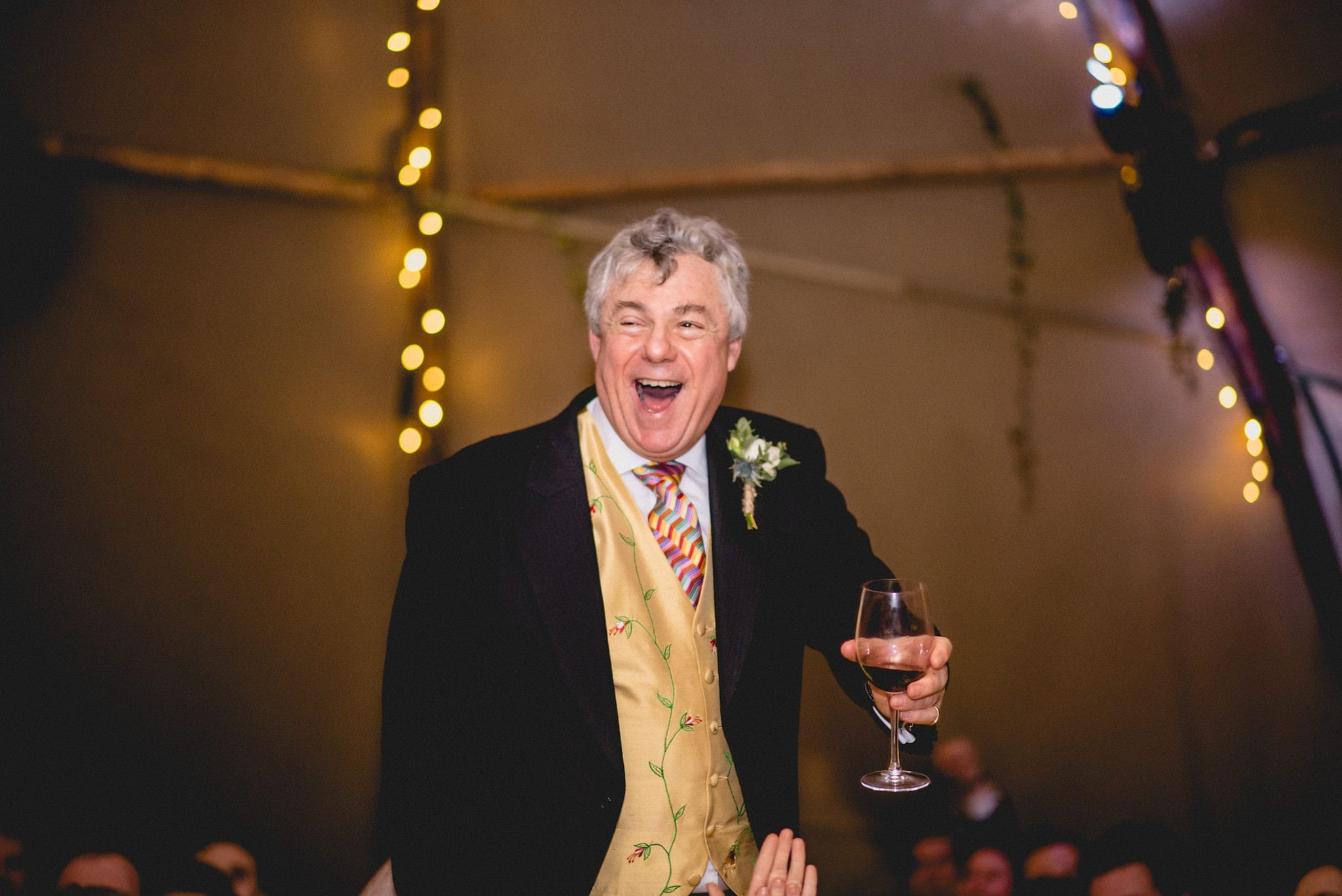 Father of the Groom laughing at a Stylish Tipi Wedding at Littlefield Manor