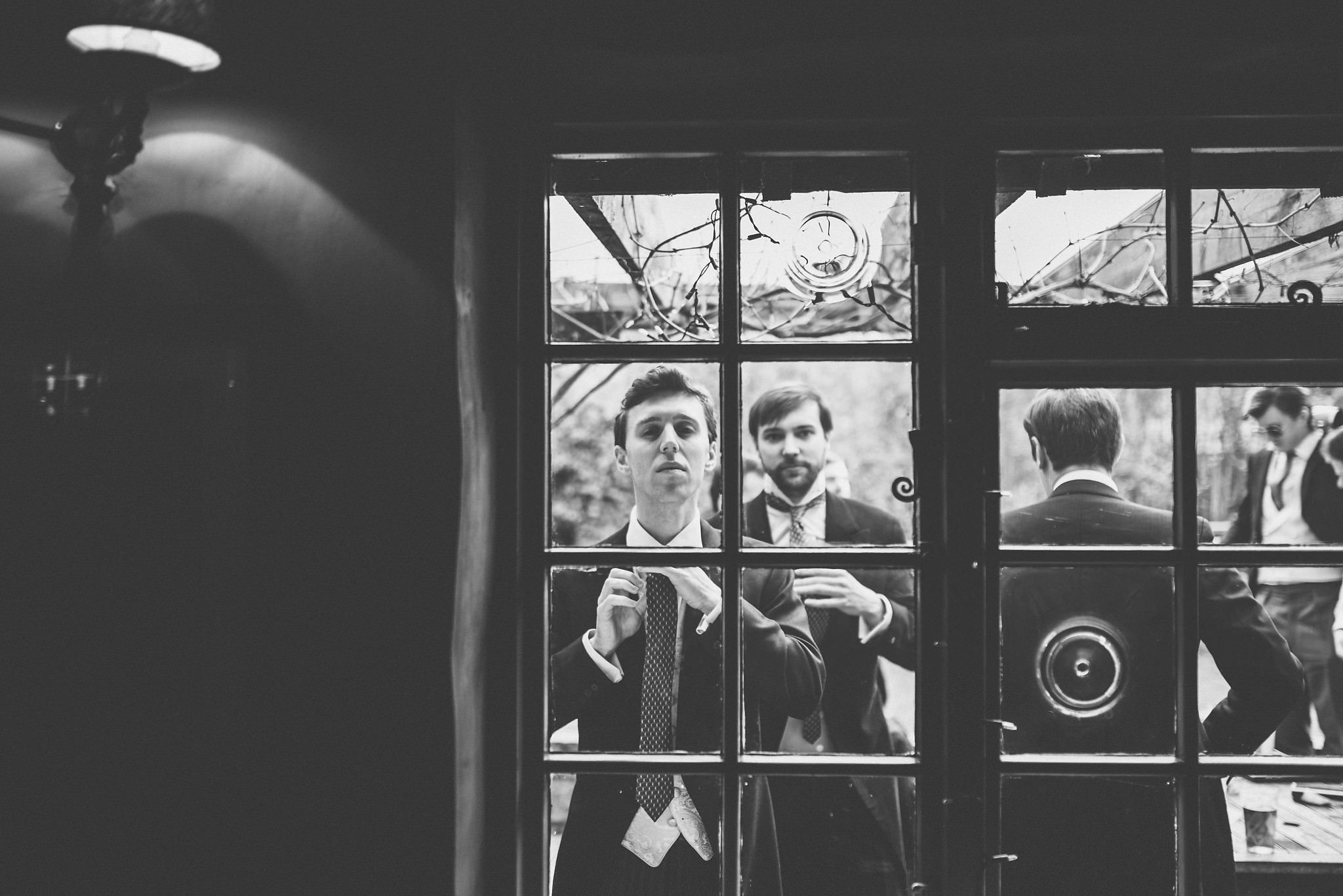 Groom and Groomsmen getting ready through the window