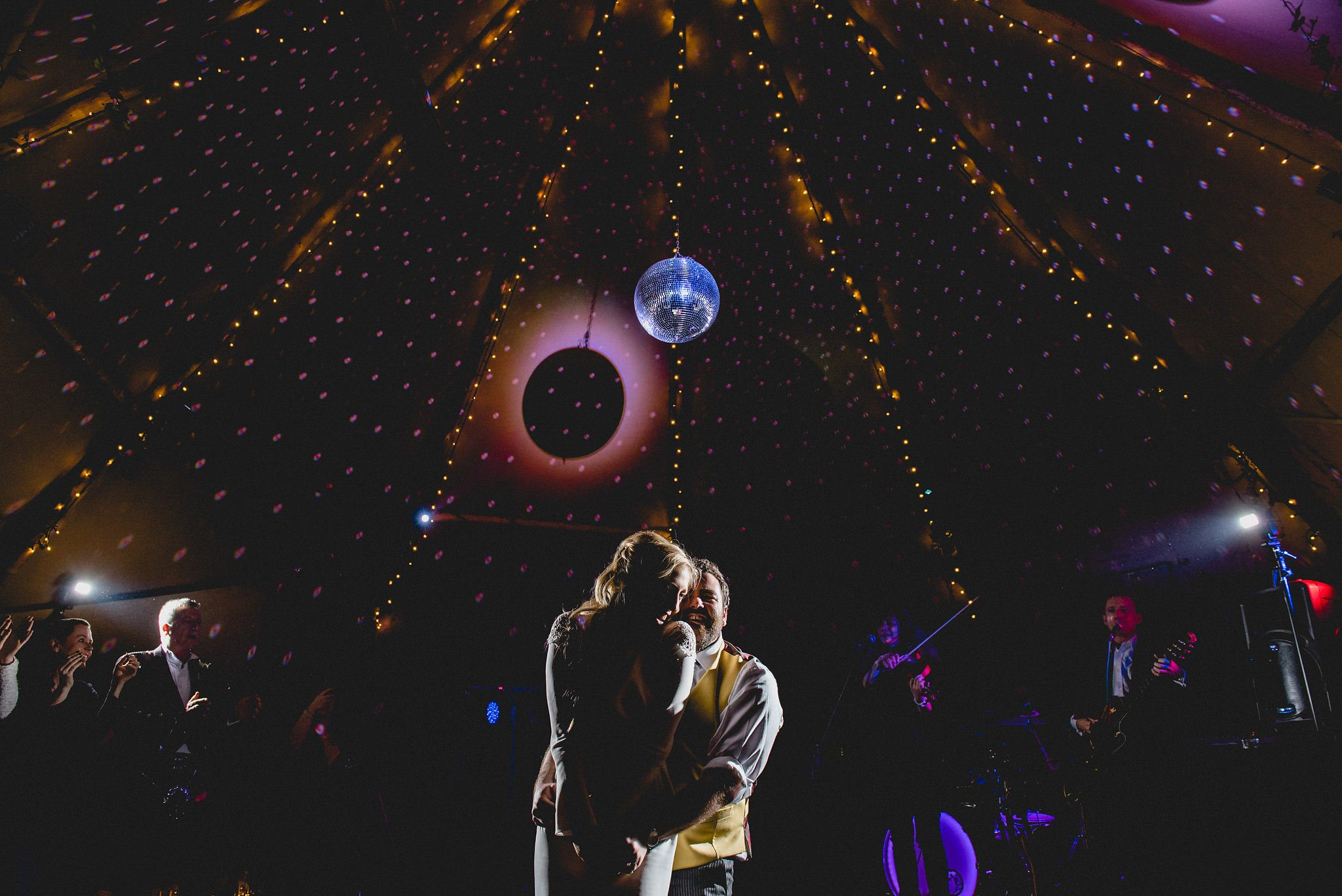 First dance in a tipi with glitter ball and purple lighting