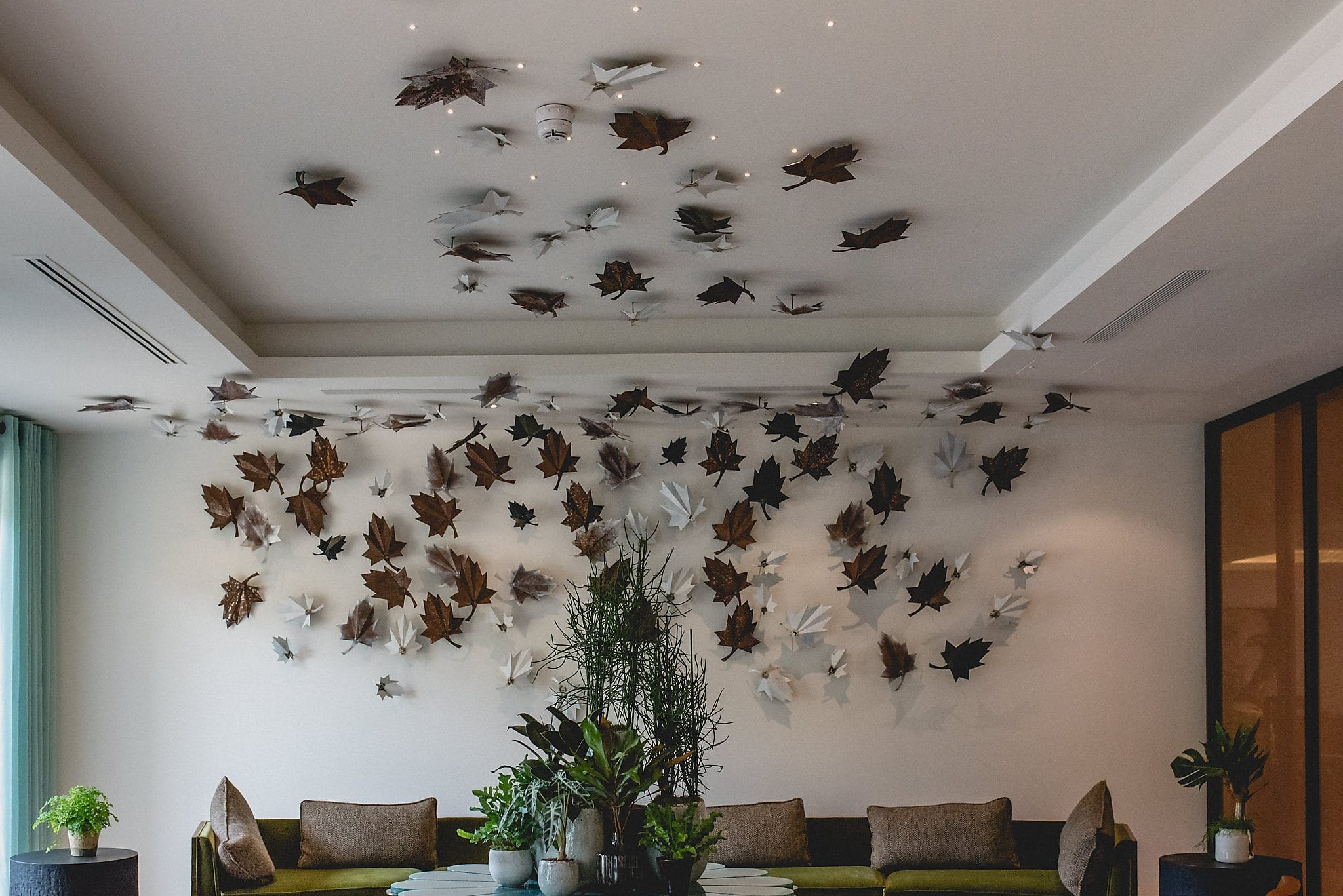 Metal leaf sculpture on the walls and ceiling at The Grove