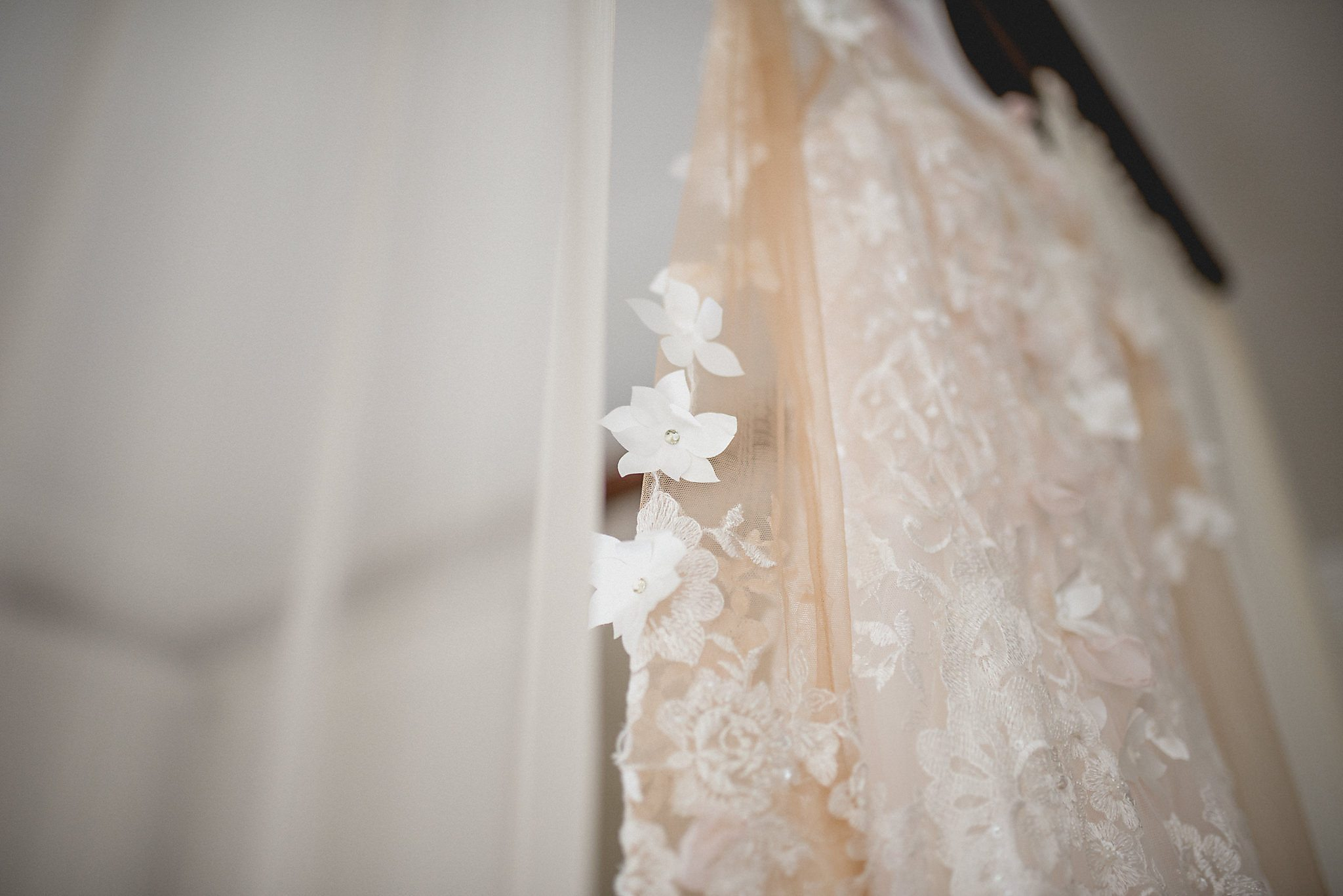 Delicate flower detail on the sleeves of bridal gown