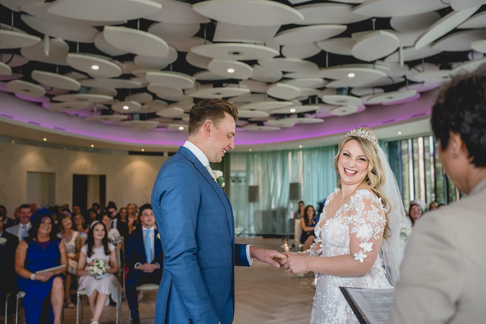 Bride and groom laugh together during their wedding ceremony