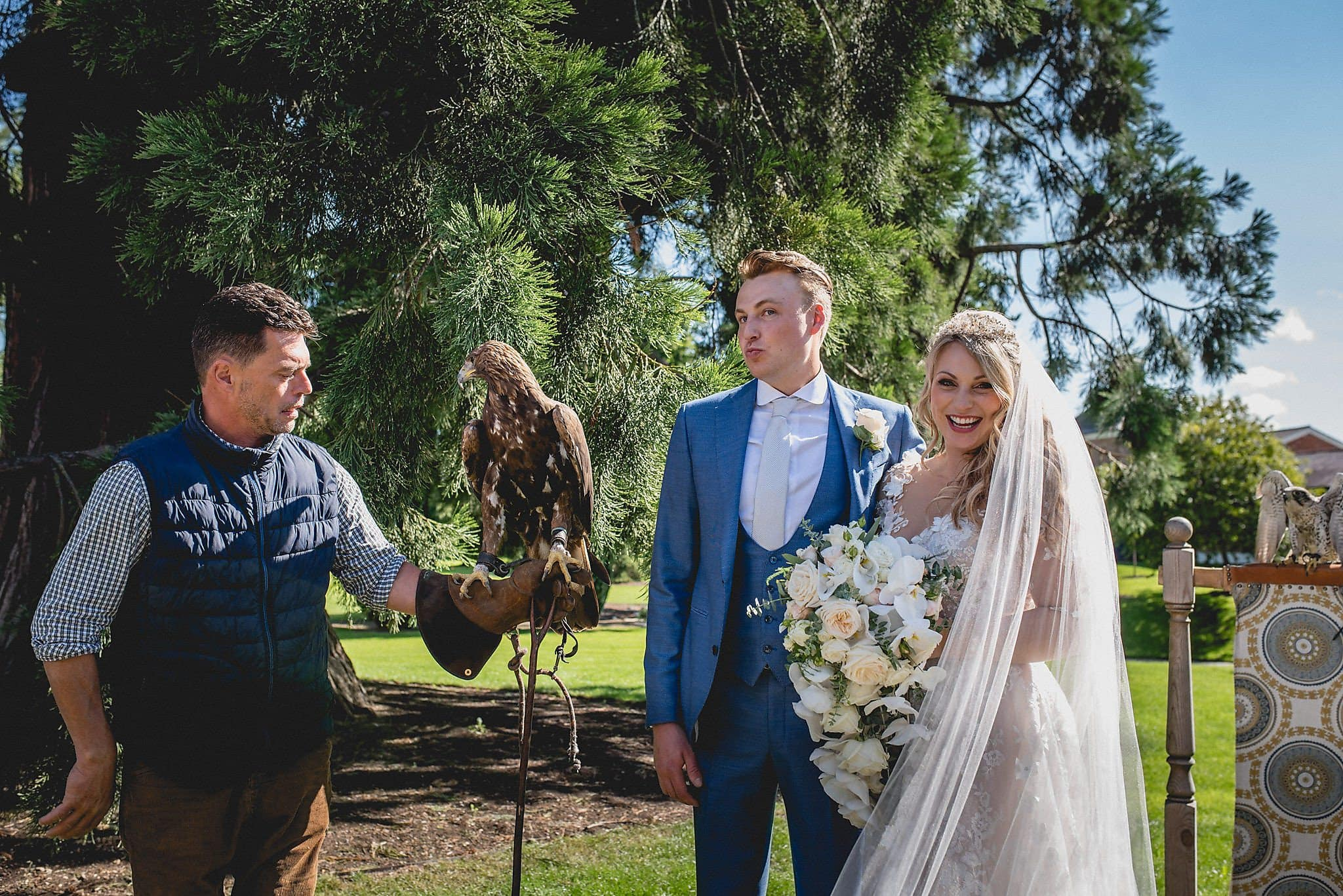 Bride and Groom pose with falcon