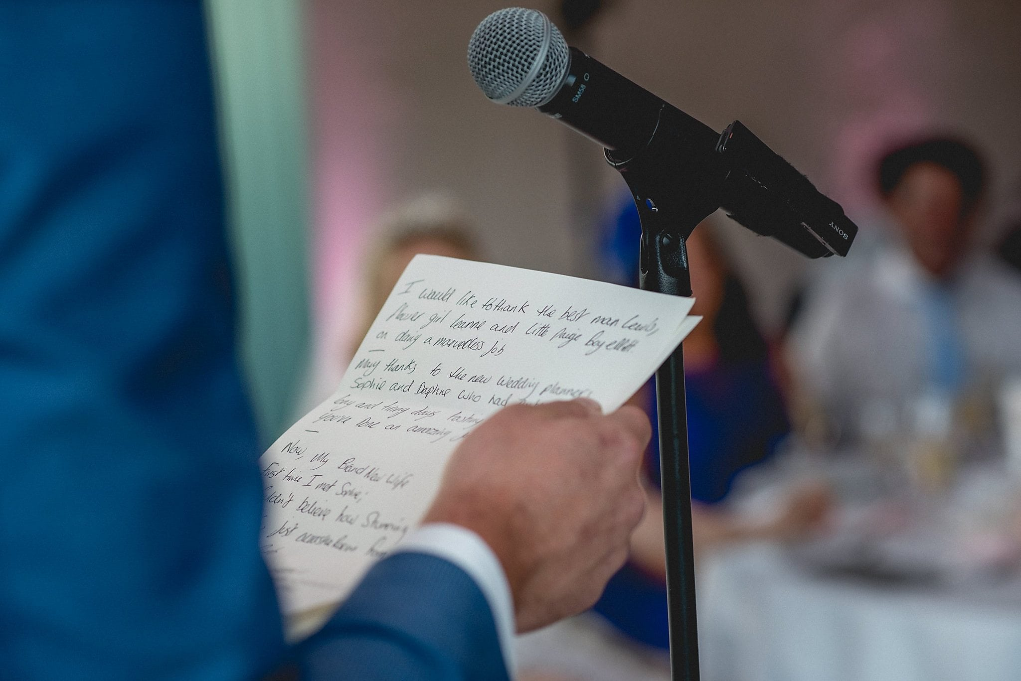 Close up of groom's speech notes as he gives his speech at the reception