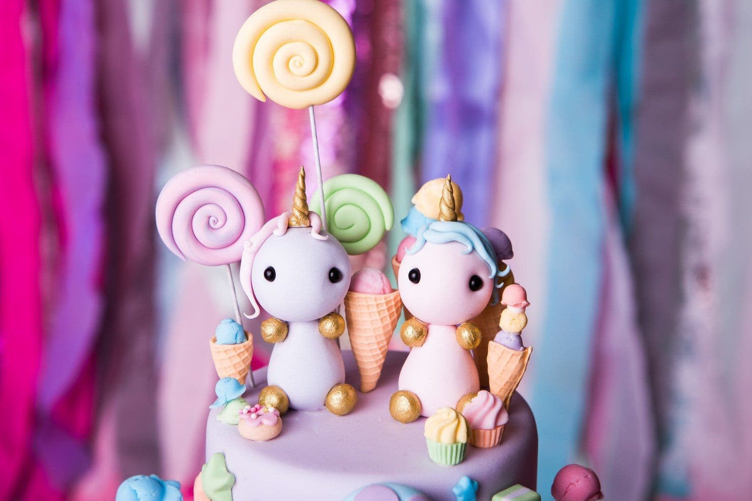 Vegan fondant cake toppers - two unicorns holding lollipops and ice creams