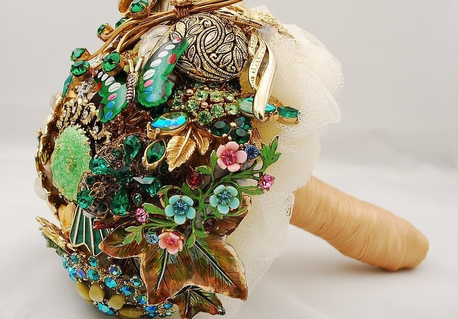 Brooch Bouquet by Nicola Garrett in blues and greens wedding flowers