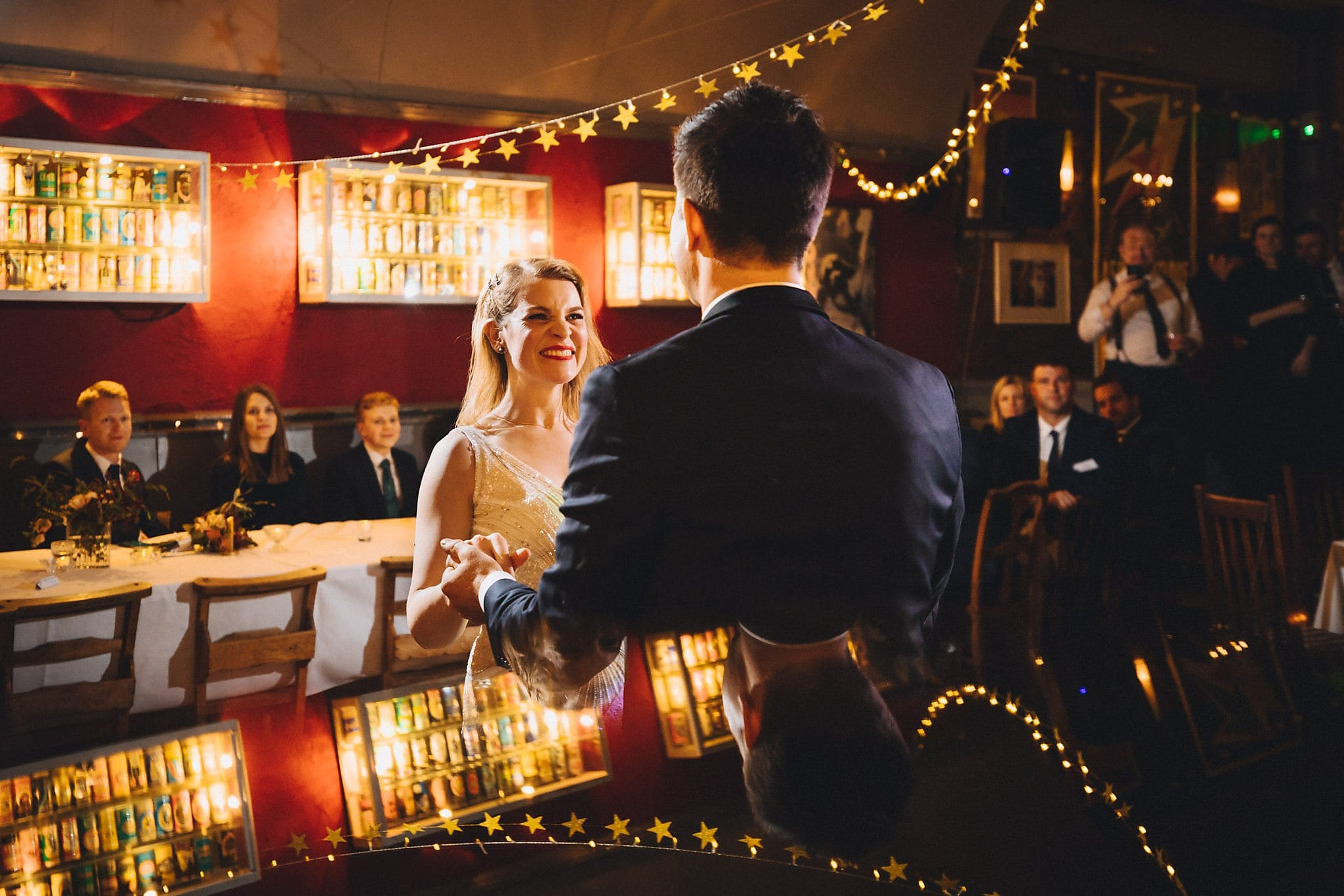 Bride and groom's happy first dance at the Londesborough Pub with guests looking on