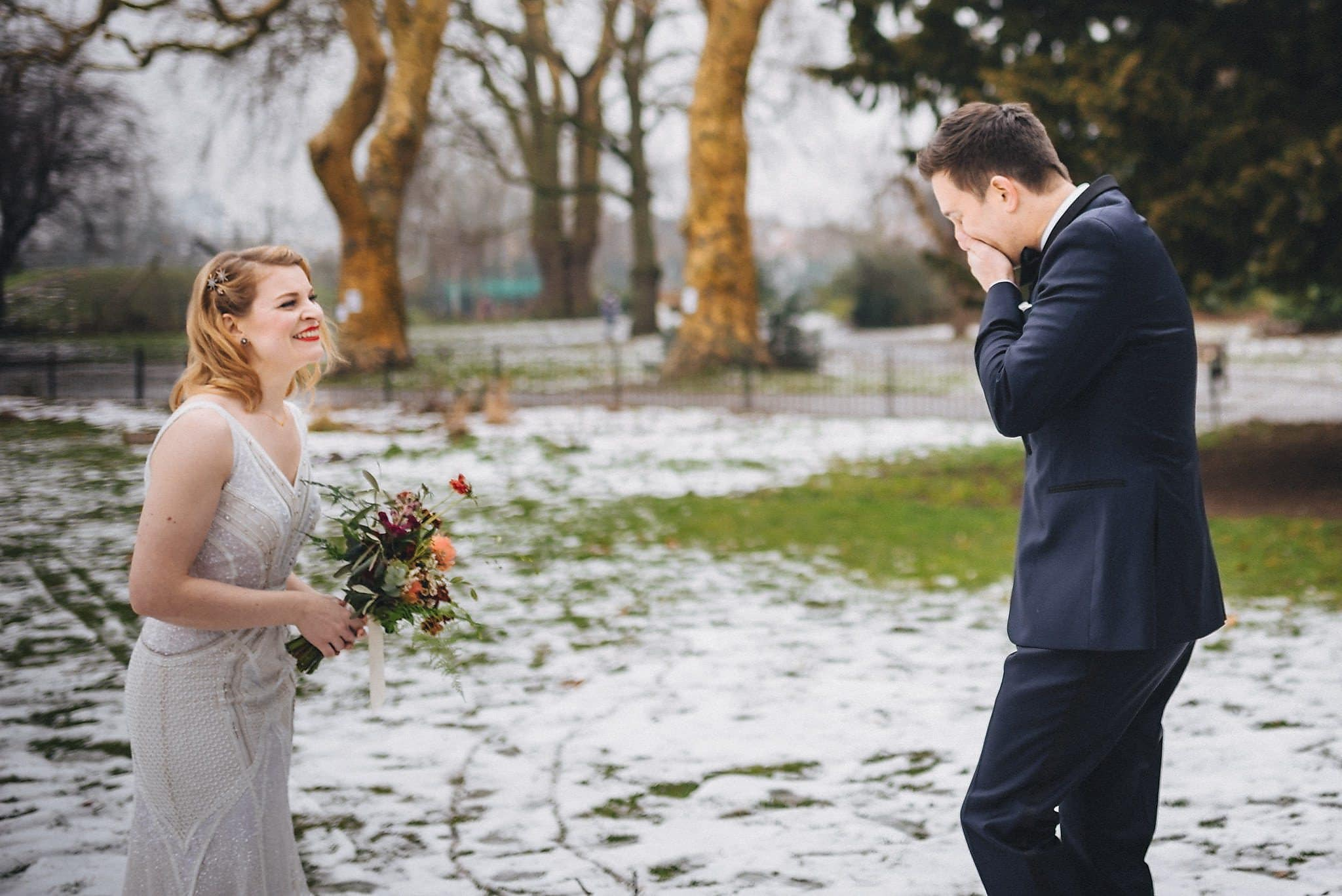 First look for bride and groom in snowy Clissold Park