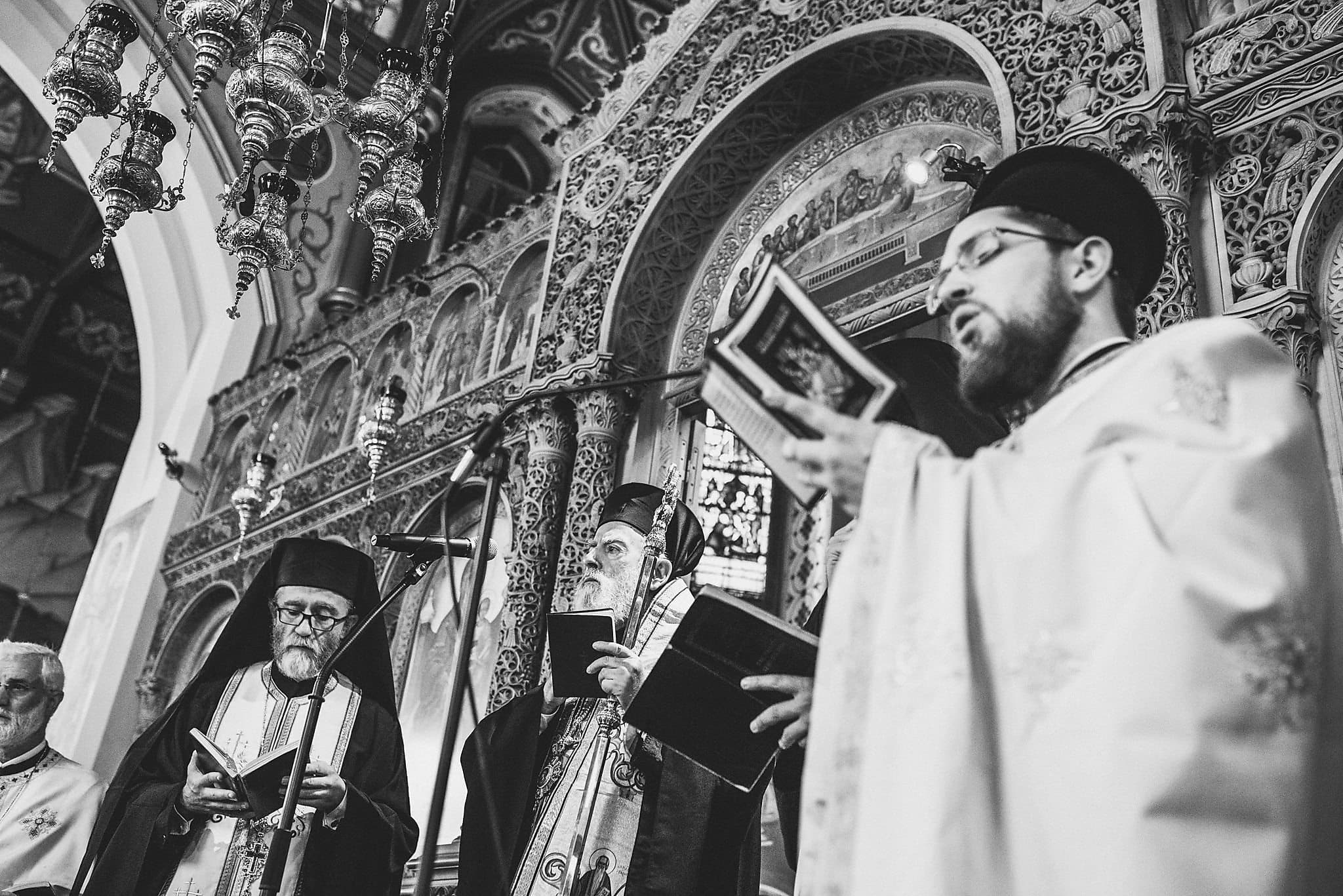 Greek priests singing hymns during a Greek Orthodox Ceremony at Saint Andrew's Greek Orthodox Church
