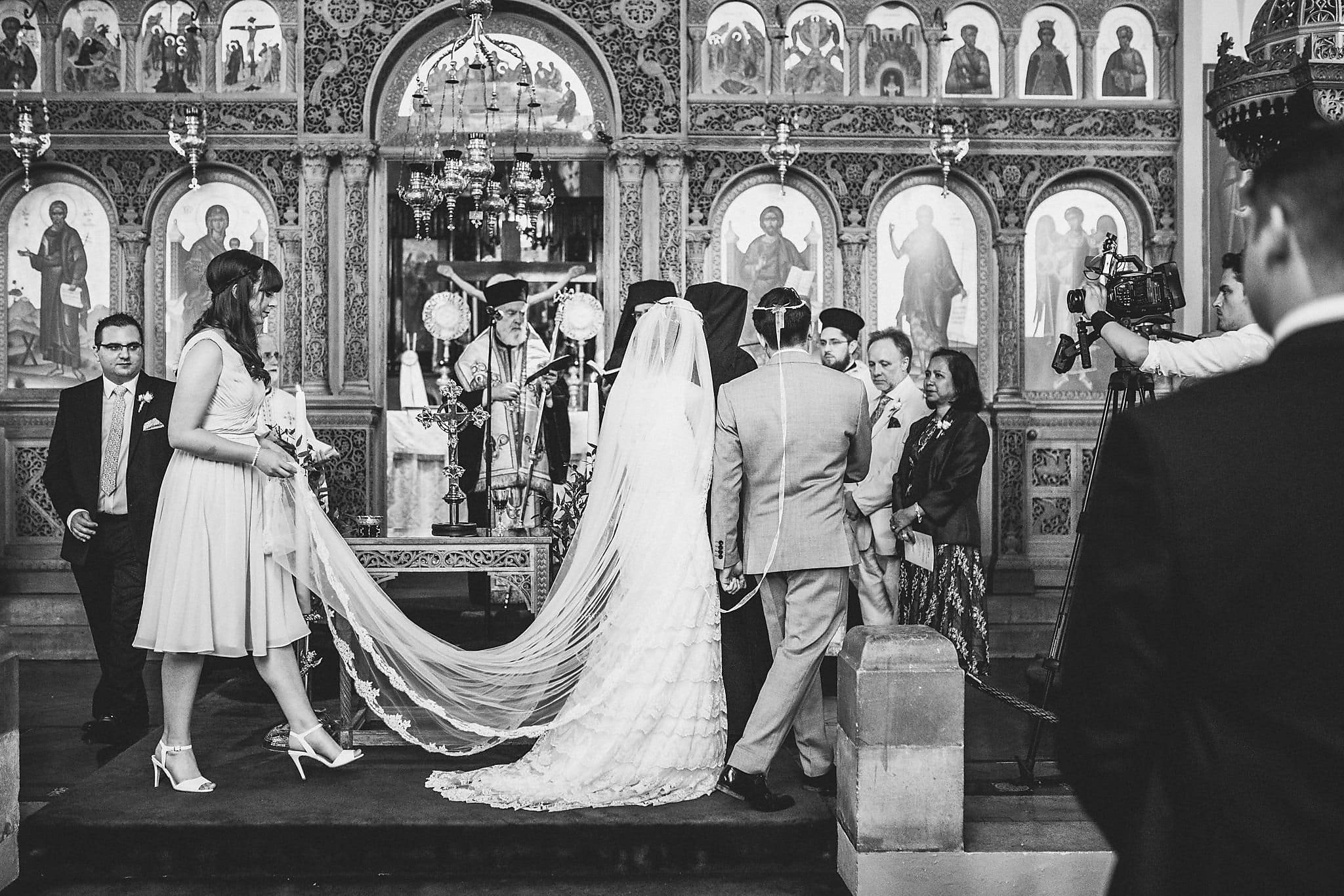Bride and Groom walking around the altar during the Greek Orthodox Wedding ceremony