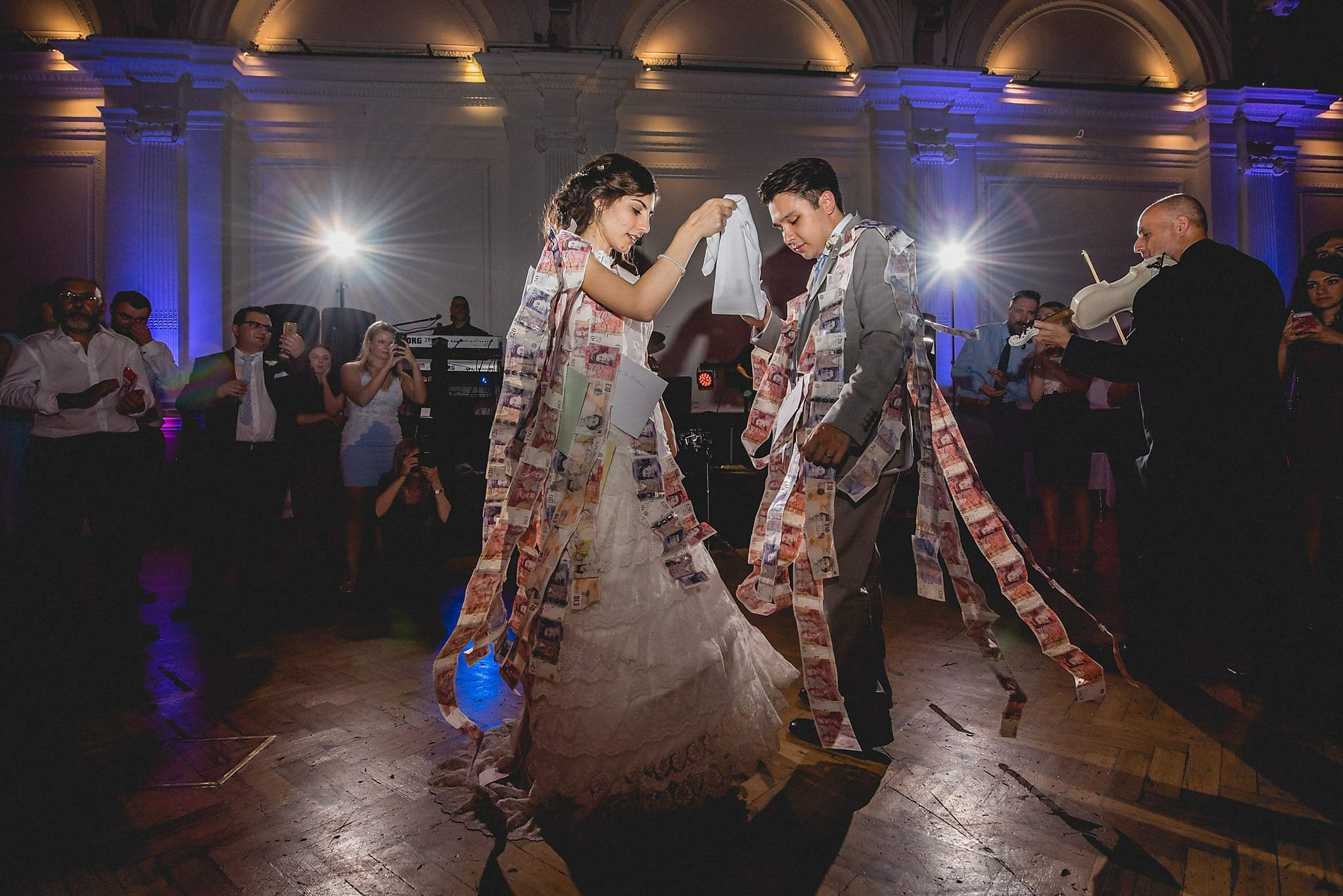 Bride and Groom dancing during Greek money dance at wedding