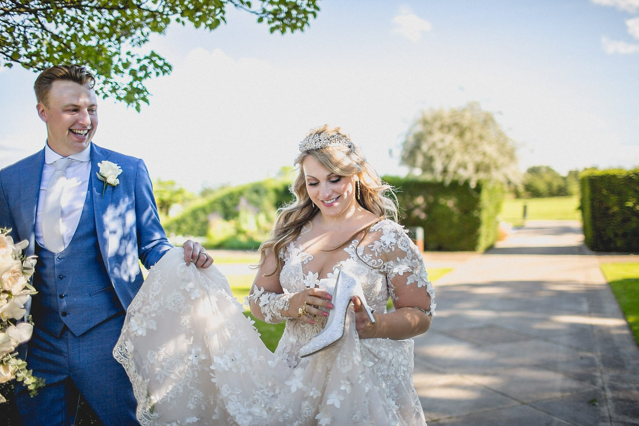Bride and Groom walking through the grounds at The Grove