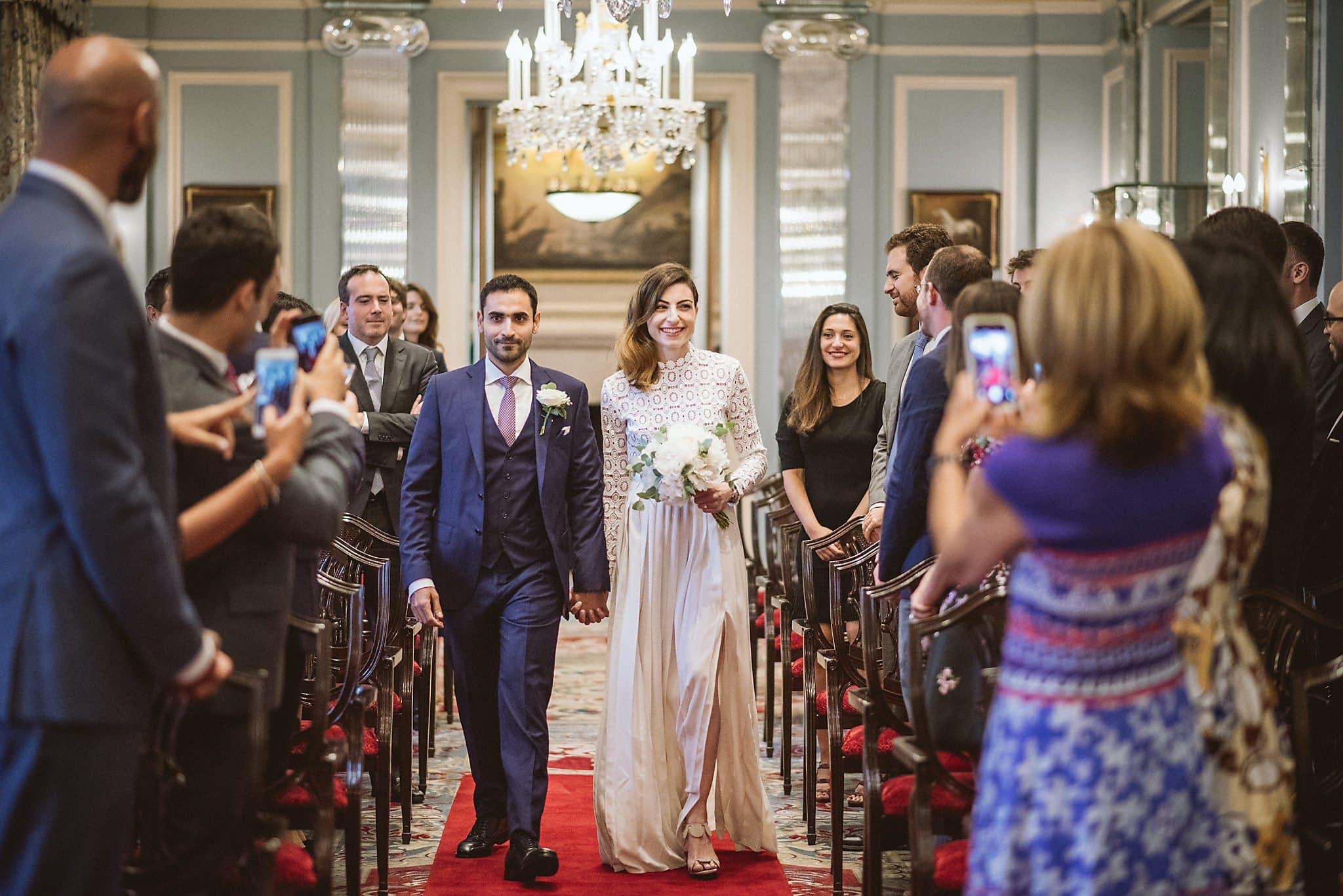 Bride and groom walk down the aisle at their Lanesborough Hotel Wedding Ceremony