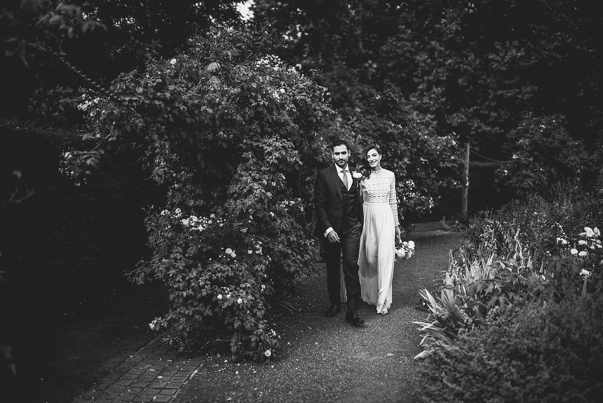 Black and white shot of bride and groom in Hyde Park