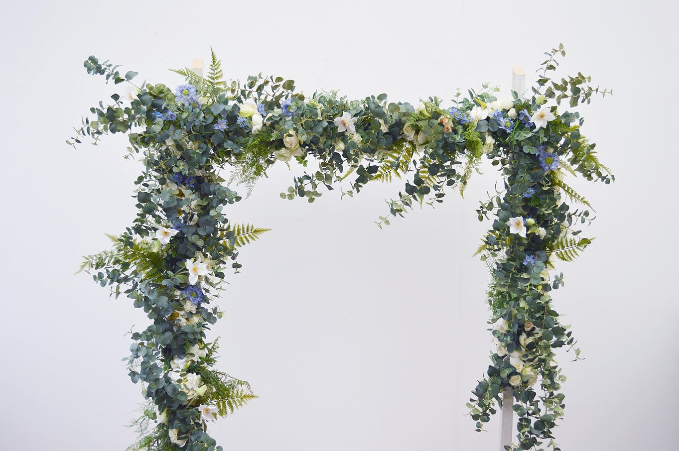 Artificial floral arch by Friend of Faux