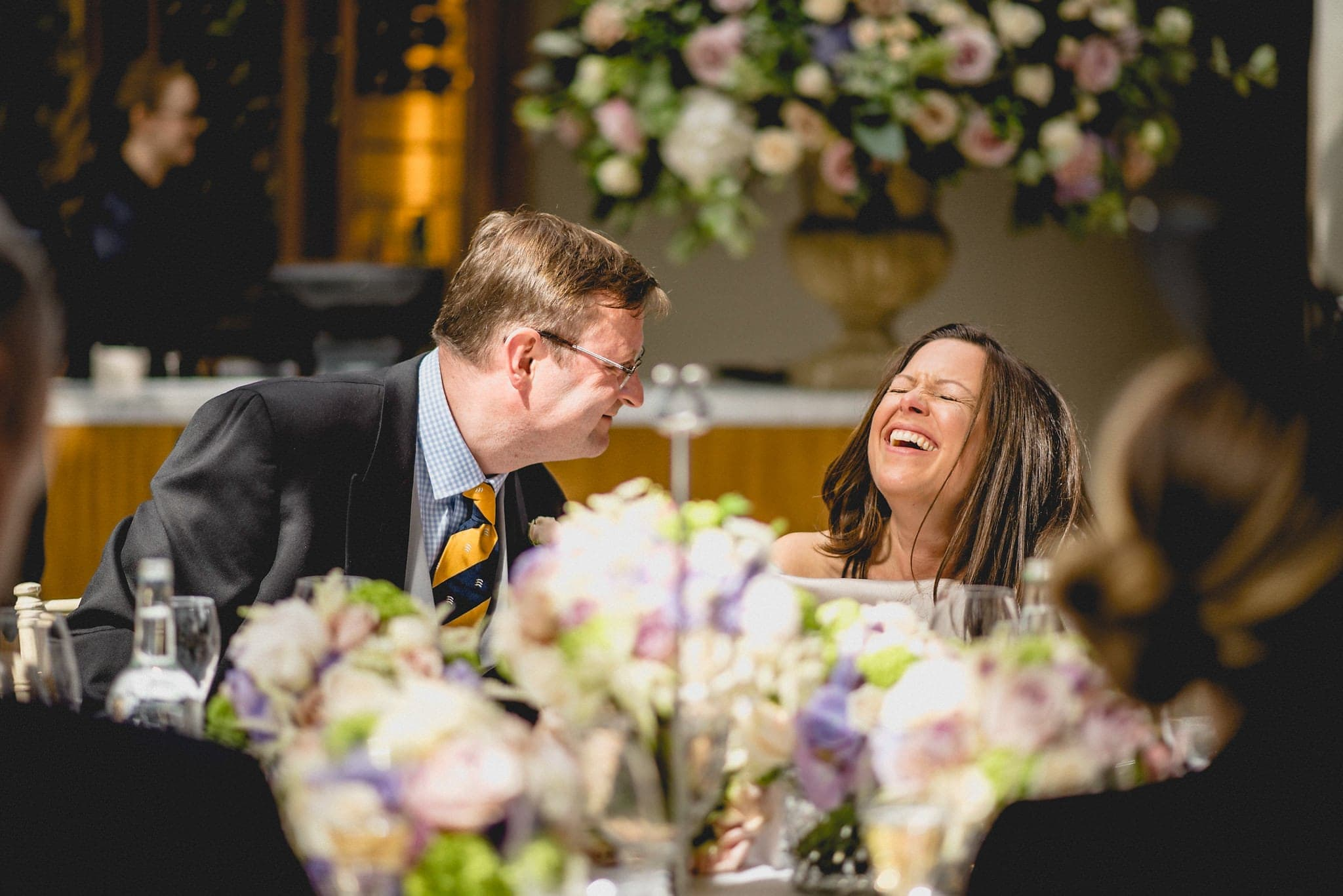 Groom makes bride laugh during speeches