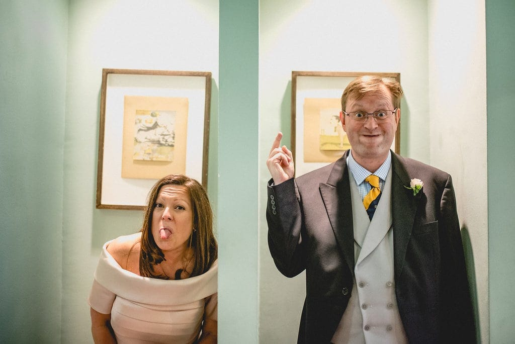 Bride and groom pull silly faces to camera