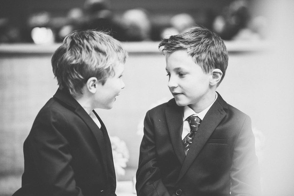 Black and white shot of two boys at wedding