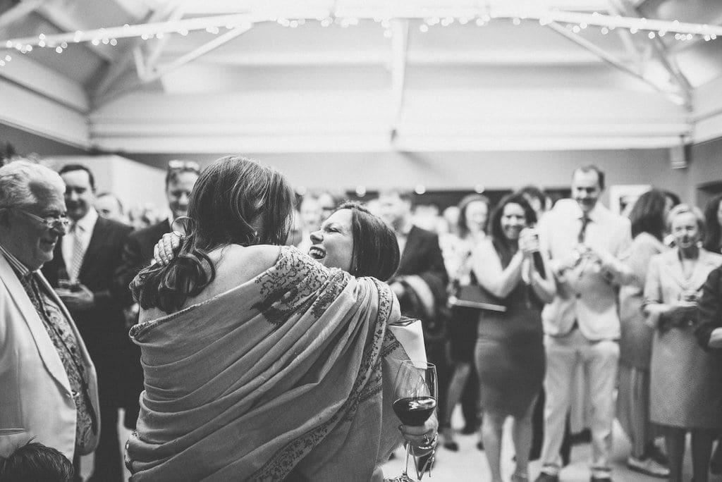 Bride hugs friend after her speech