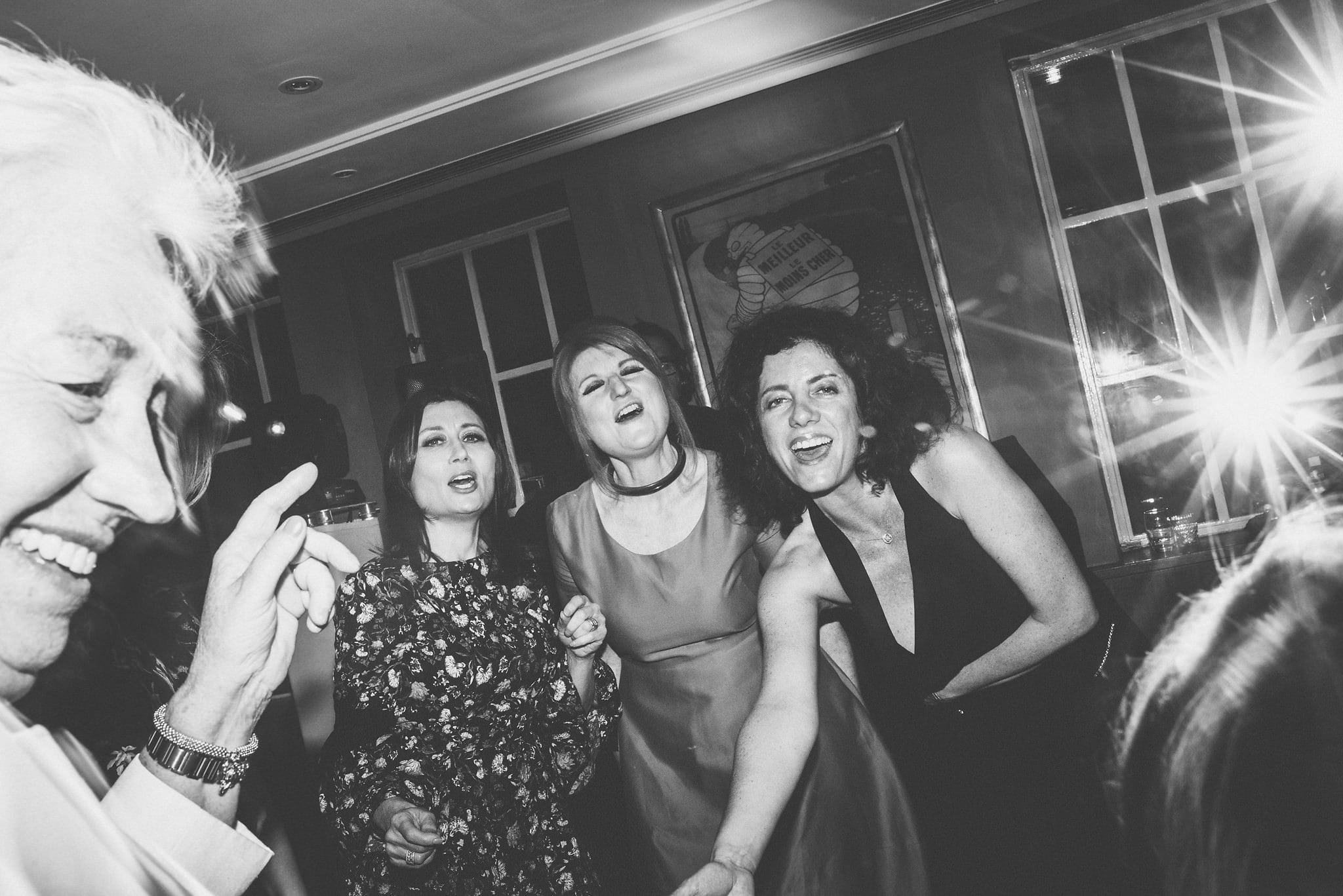 Black and white shot of guests on dancefloor at Chelsea Bluebird wedding